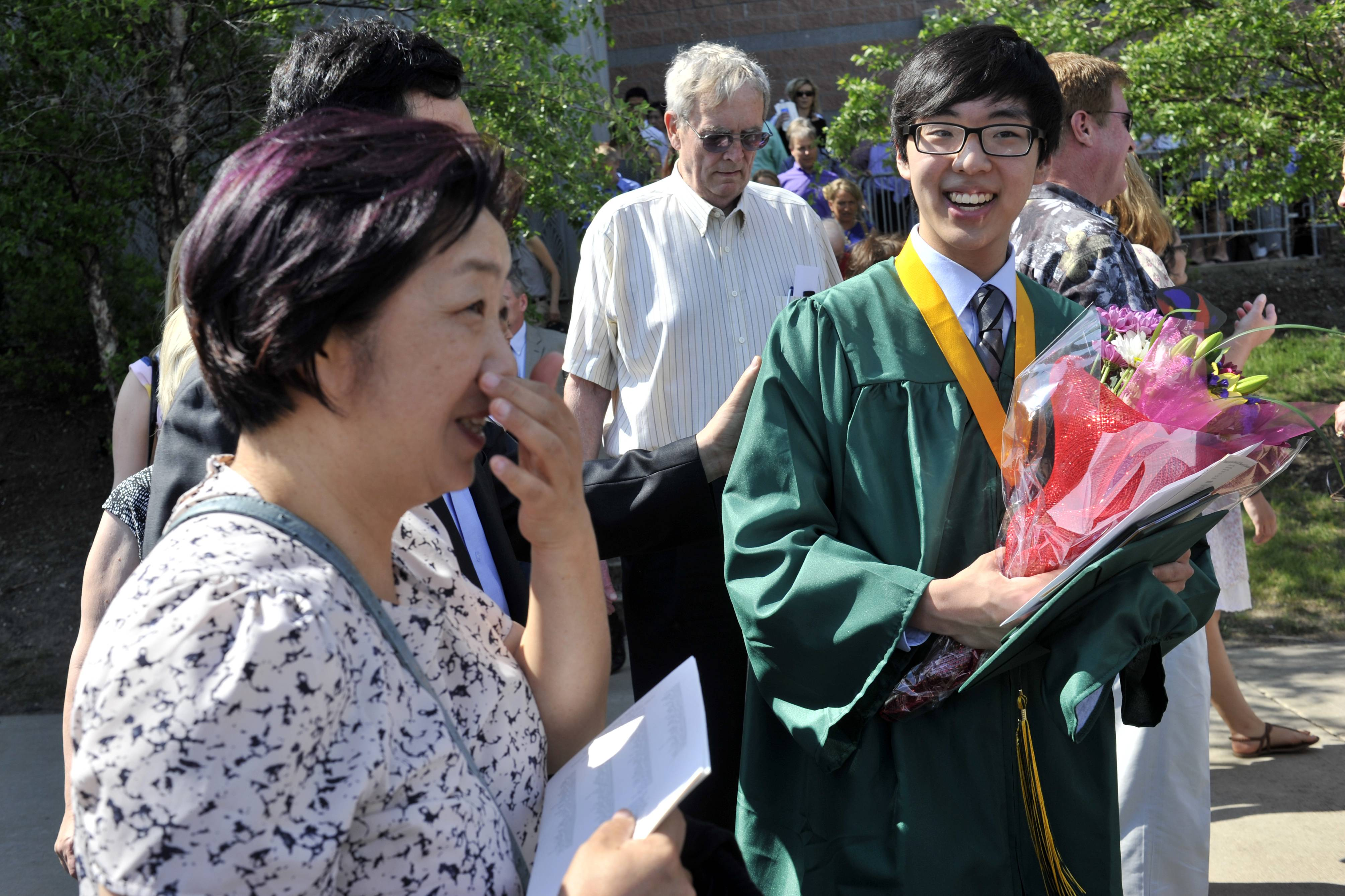 Tae Won Hur is greeted by his mother Hanna Hur of Hoffman Estates after the William Fremd High School commencement at Sears Centre in Hoffman Estates on Sunday, June 1.