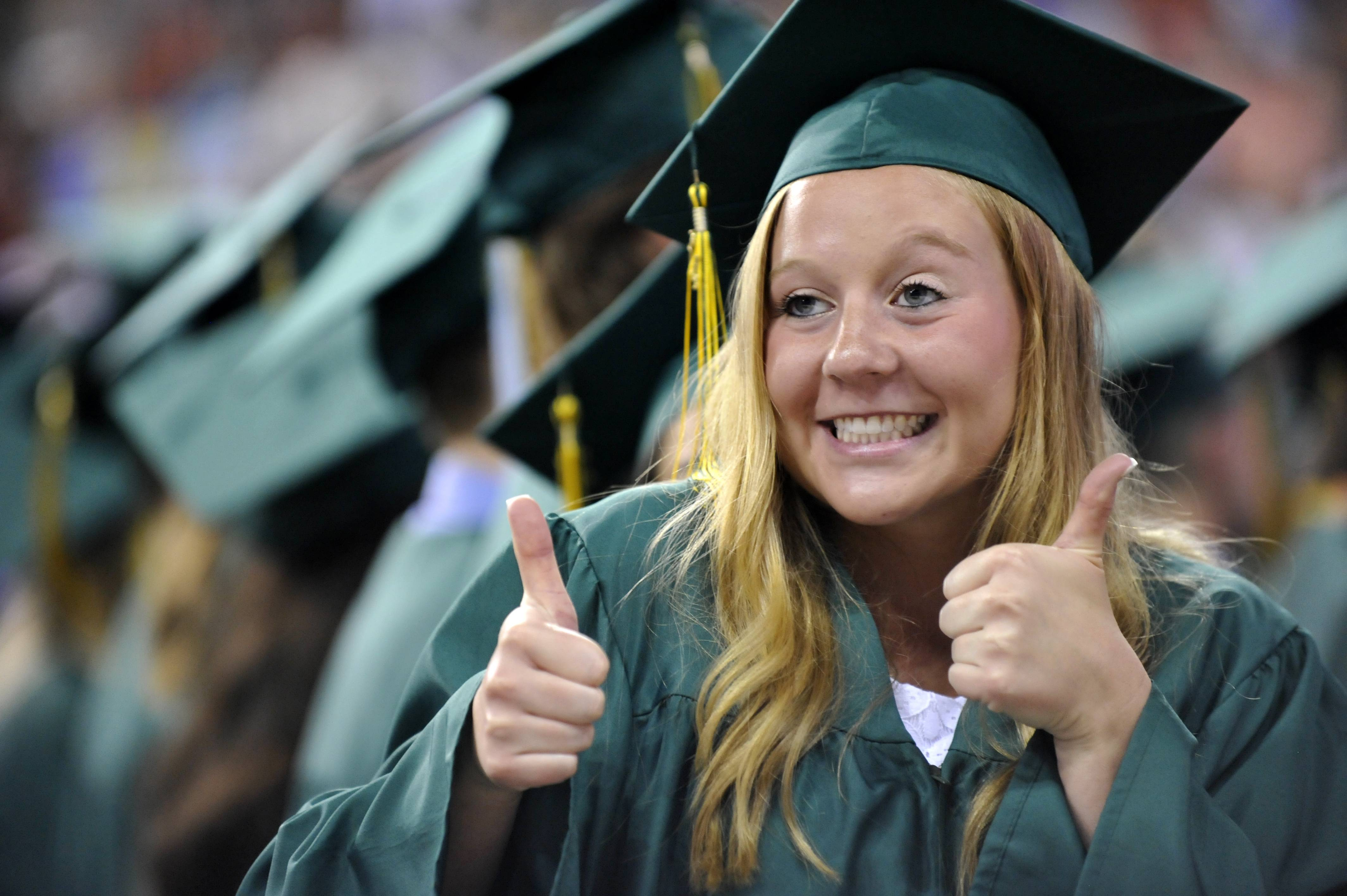 Emily Myers of Palatine gives thumbs-up as she looks into the audience during the William Fremd High School commencement at Sears Centre in Hoffman Estates on Sunday, June 1.