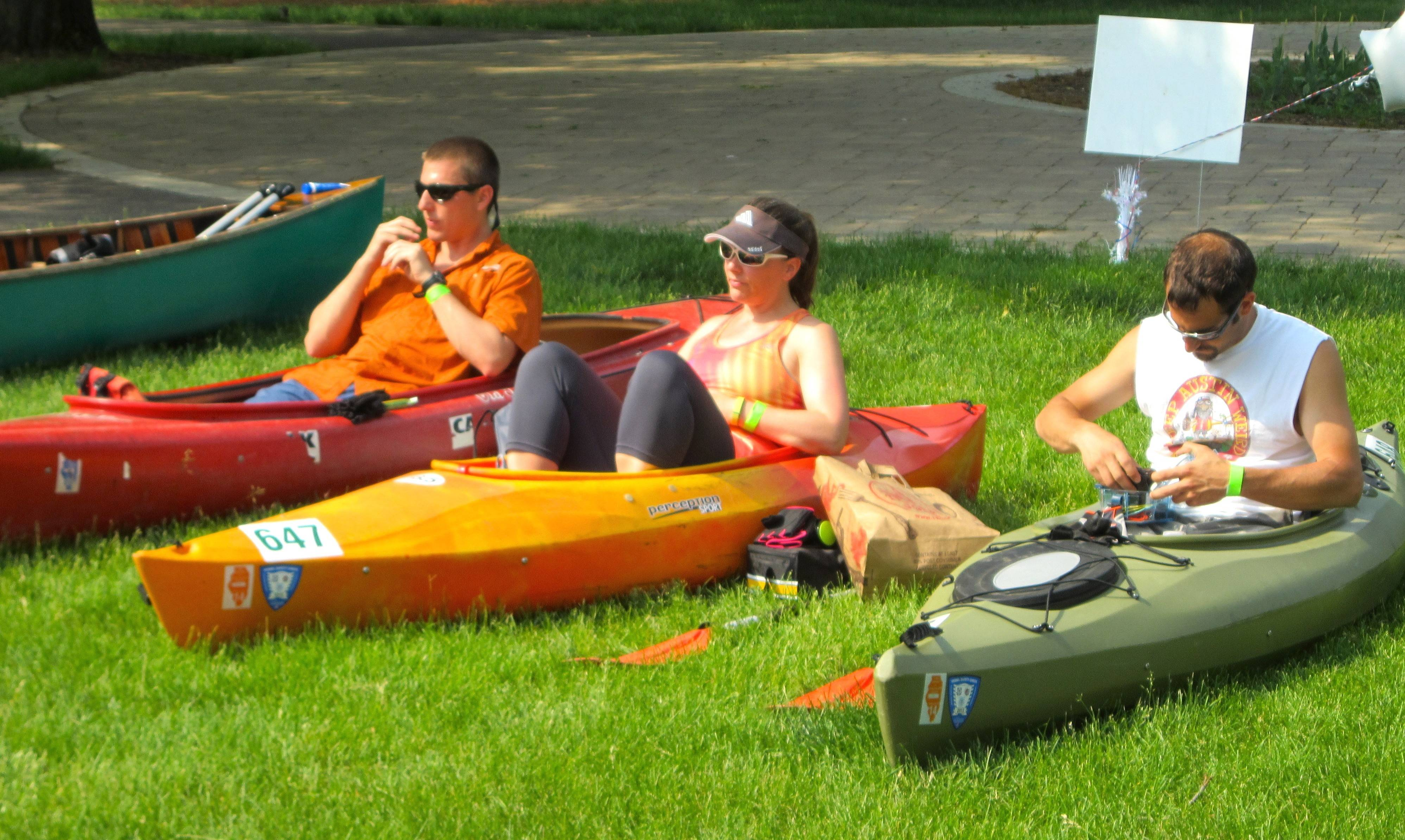 Anthony Bentivegna, left, Michelle Wilson and Joe Catella wait for their chance to do some kayaking Sunday in the 53rd annual Mid-American Canoe and Kayak Race, organized by the Fox Valley Park District.