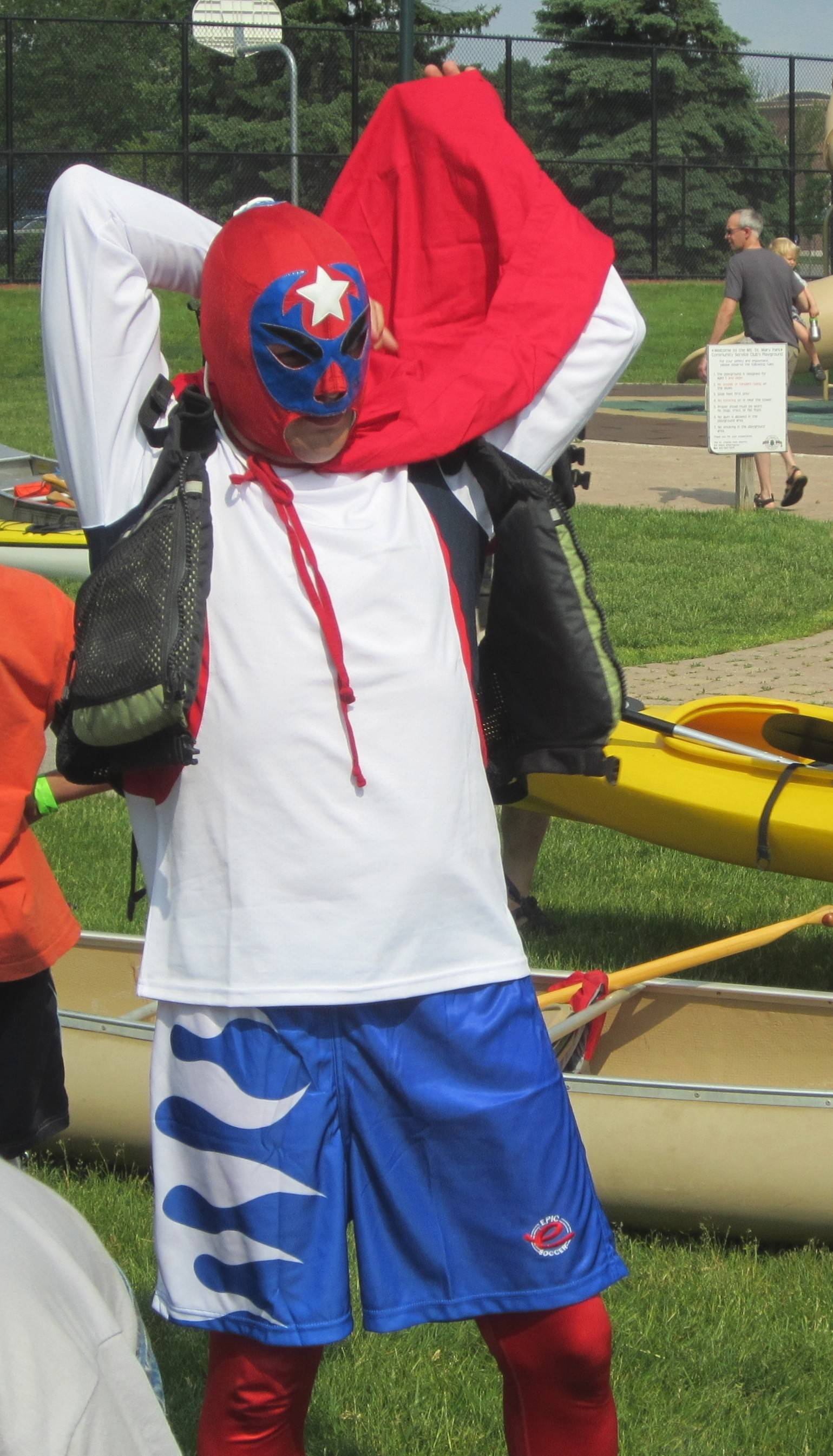 Wally Werderich of Yorkville, a longtime participant in the Mid-American Canoe and Kayak Race, arrived at Mount St. Mary Park in St. Charles on Sunday in a costume that resembled those worn by some professional wrestlers in Mexico.