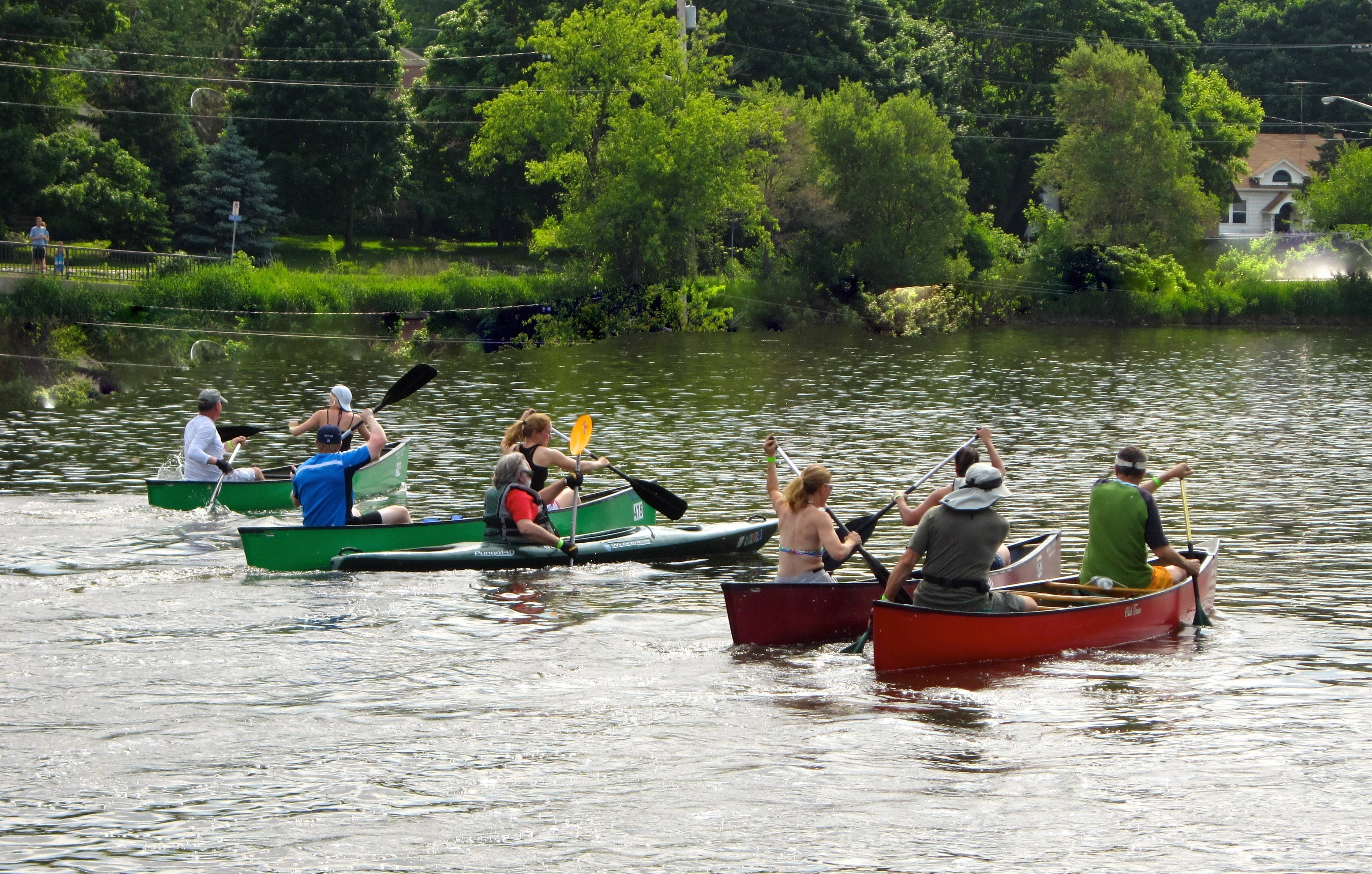 Participants in the 53rd annual Mid-American Canoe and Kayak Race head down the Fox River on Sunday.