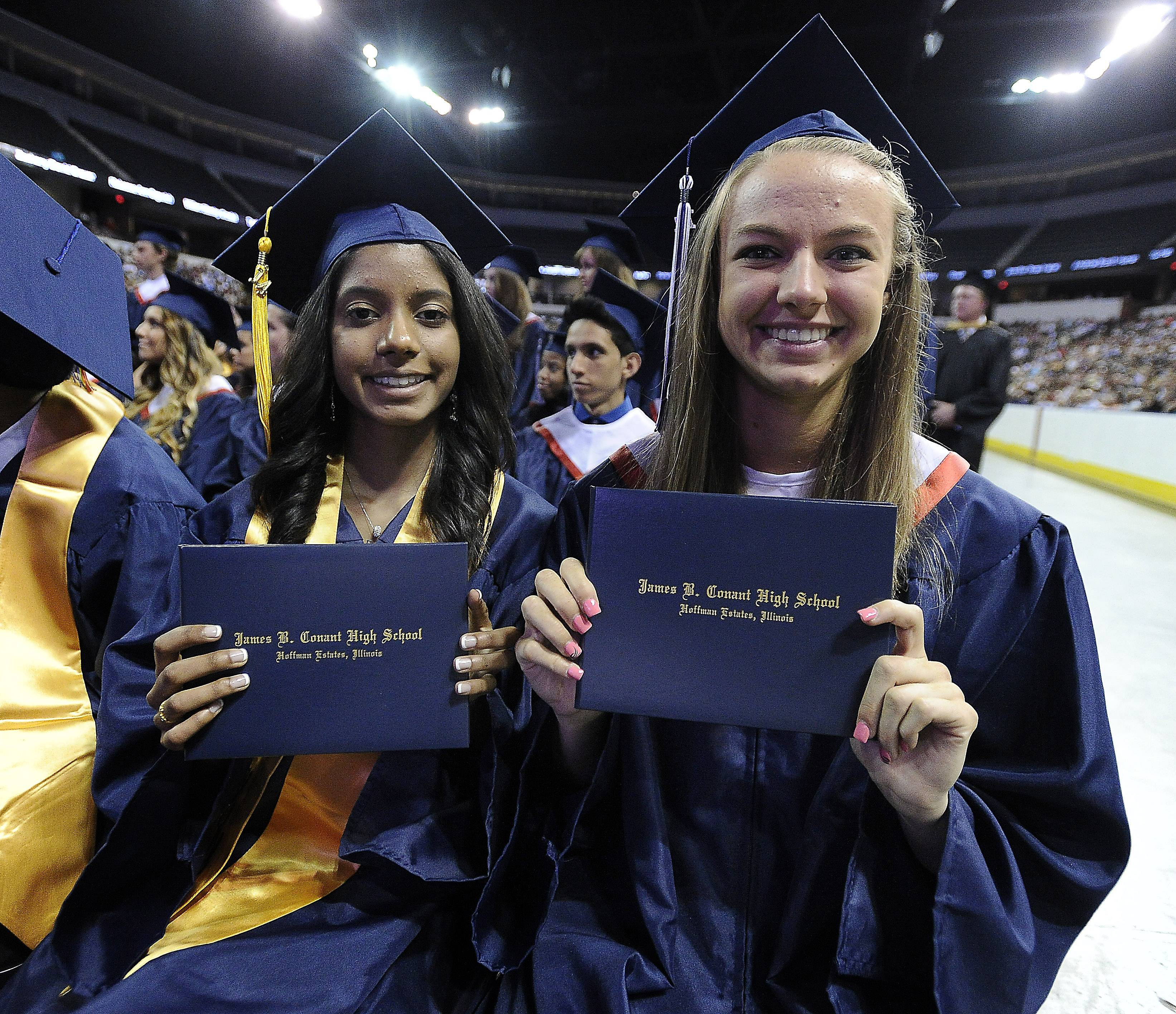Rishika Bheem, 18, of Roselle and Abigail Barthel, 18, of Schaumburg were the first two to get their diplomas at the 49th annual commencement of Conant High School at the Sears Centre on Sunday.