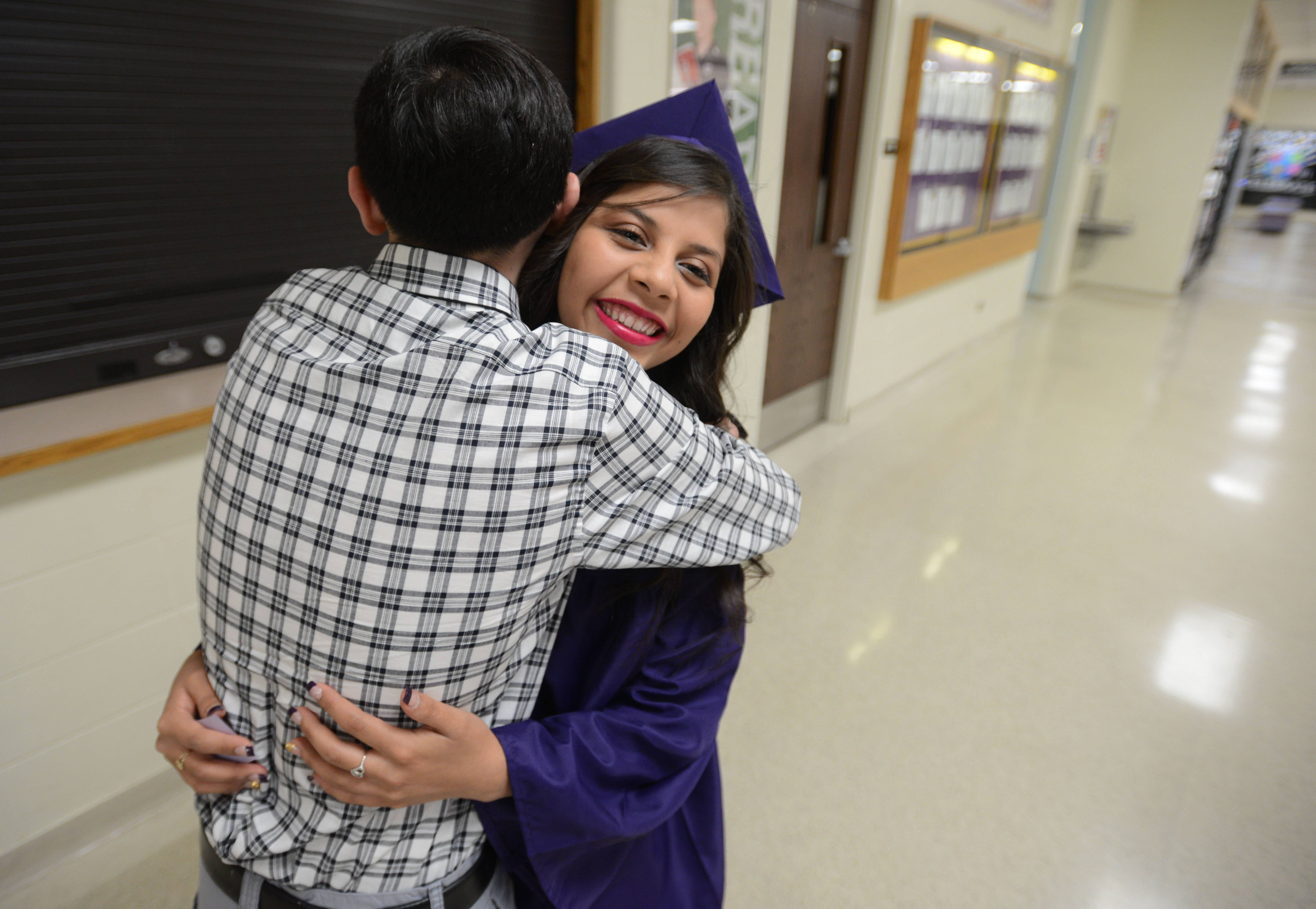 Jorge Hernandez, 18, of Mount Prospect hugs Nancy Mendez, 17, of Arlington Heights at the Rolling Meadows High School graduation Sunday.
