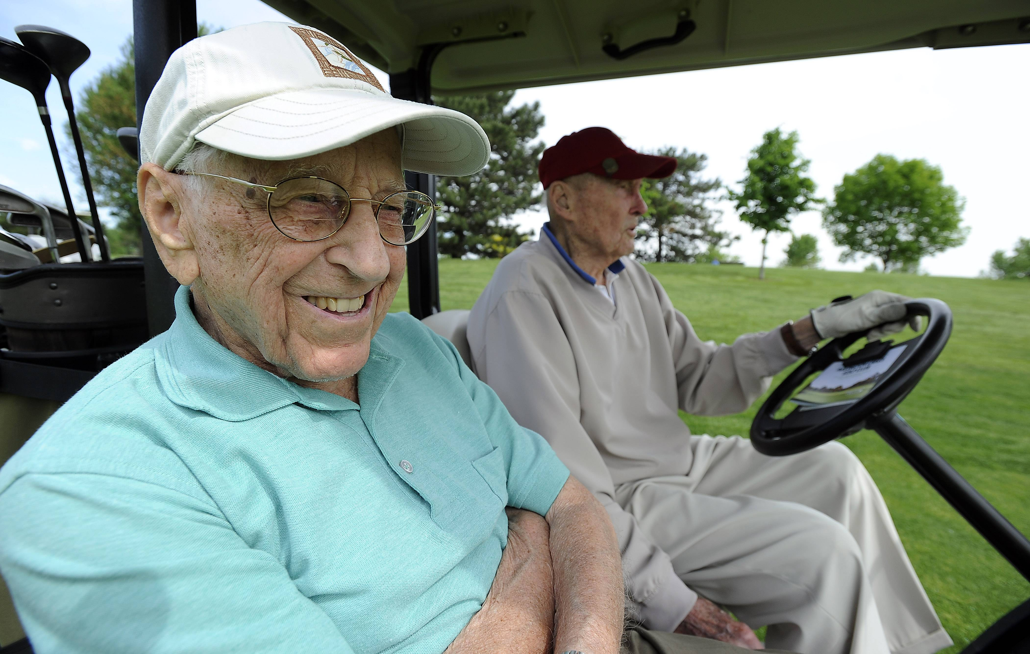 Agreeing to use a golf cart is the only concession to age made by golfers Dick Muhlethaler, left, 103, and Dick Breeden, 98. The pair golf every Tuesday and often score half their ages for nine holes.