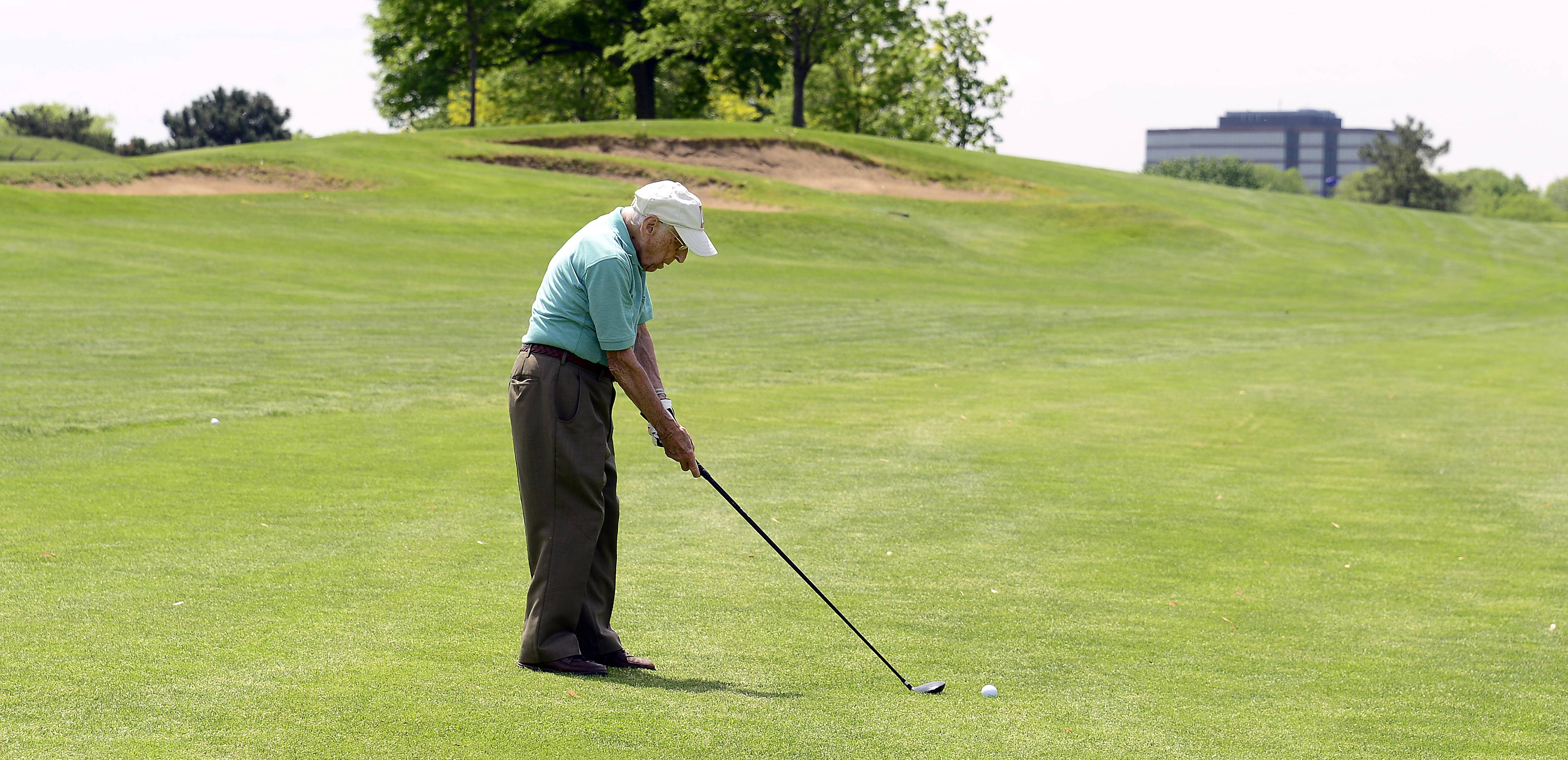 Hitting the ball straight almost every time helps golfer Dick Muhlethaler stay competitive at age 103. He and golfing partner Dick Breeden, 98, play every Tuesday at Arlington Lakes Golf Club in Arlington Heights.