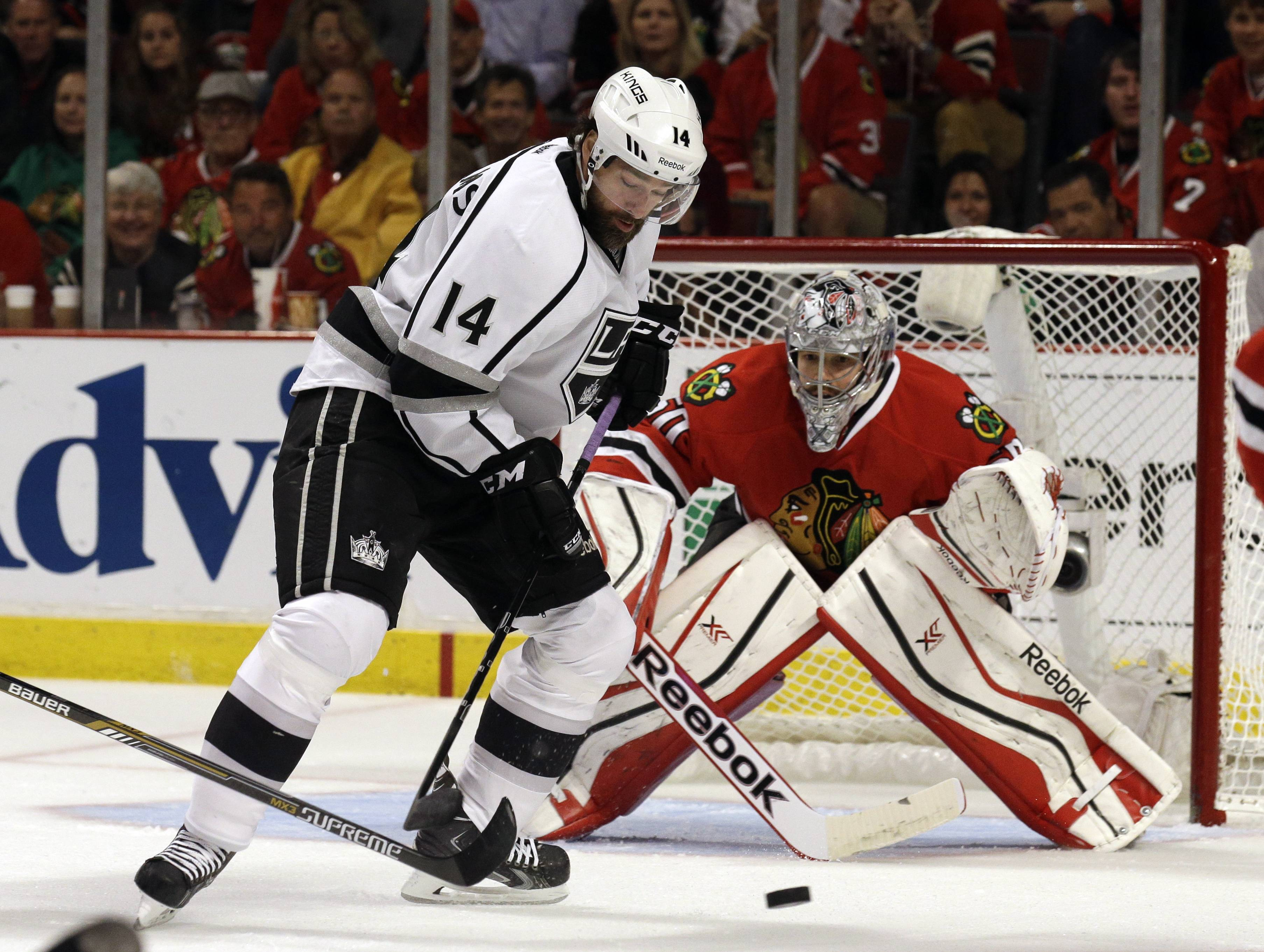 Los Angeles Kings right wing Justin Williams (14) attempts to shoot against Chicago Blackhawks goalie Corey Crawford (50) during the first period in Game 7 of the Western Conference finals in the NHL hockey Stanley Cup playoffs Sunday, June 1, 2014, in Chicago.