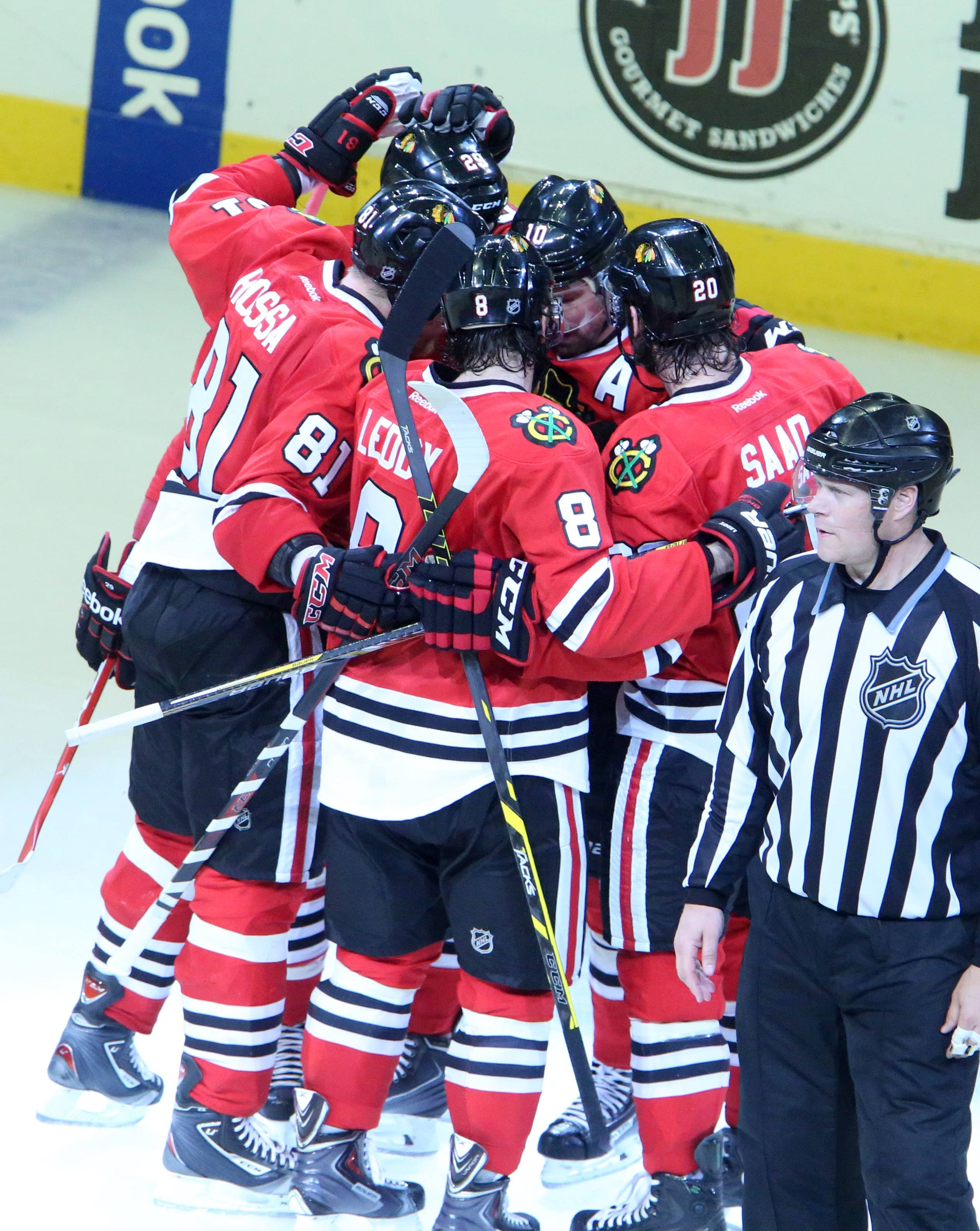 Chicago Blackhawks celebrate a goal by left wing Patrick Sharp in the second period of Game 7 of the Western Conference finals Sunday at the United Center in Chicago.