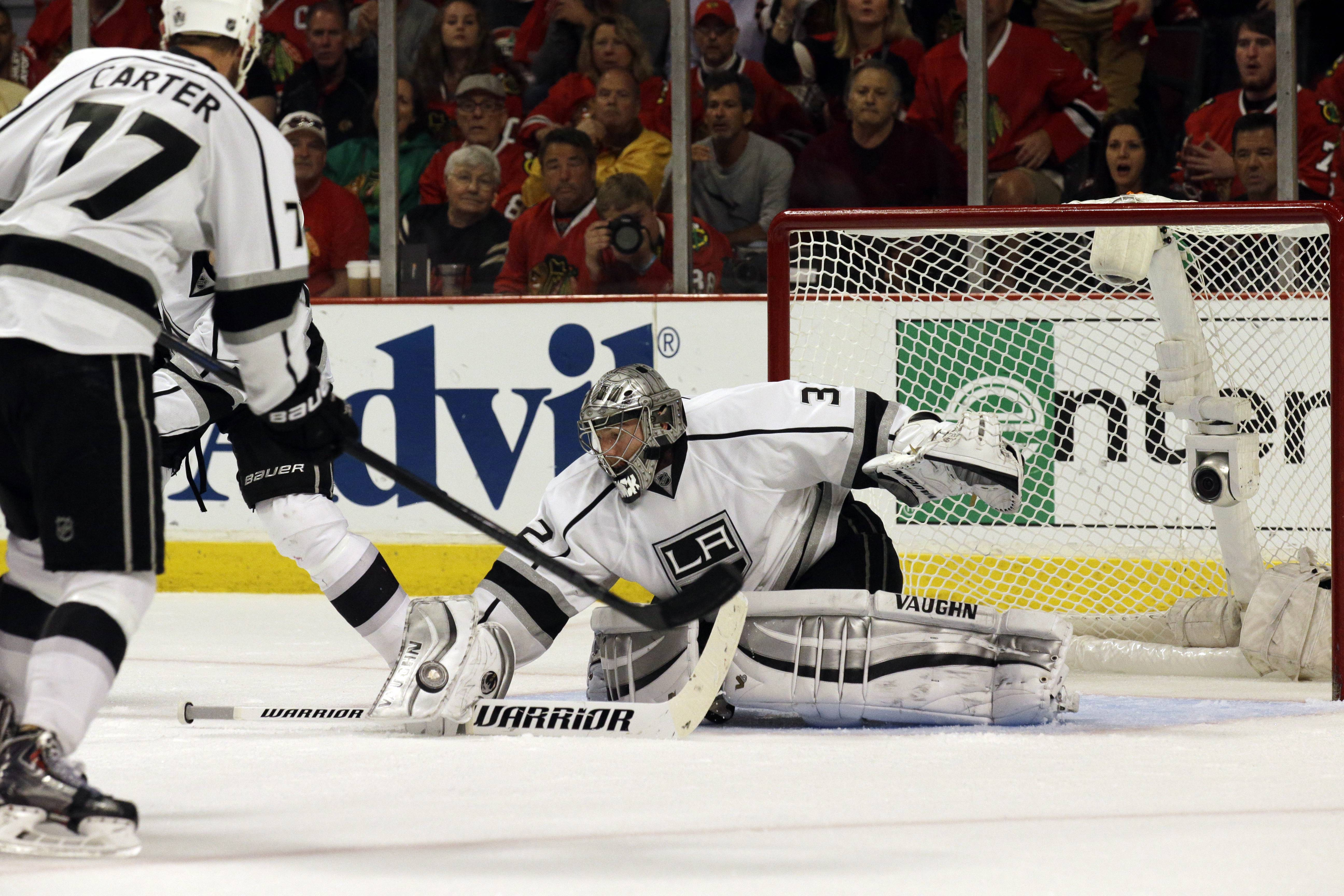 Los Angeles Kings goalie Jonathan Quick (32) saves a goal during the second period.