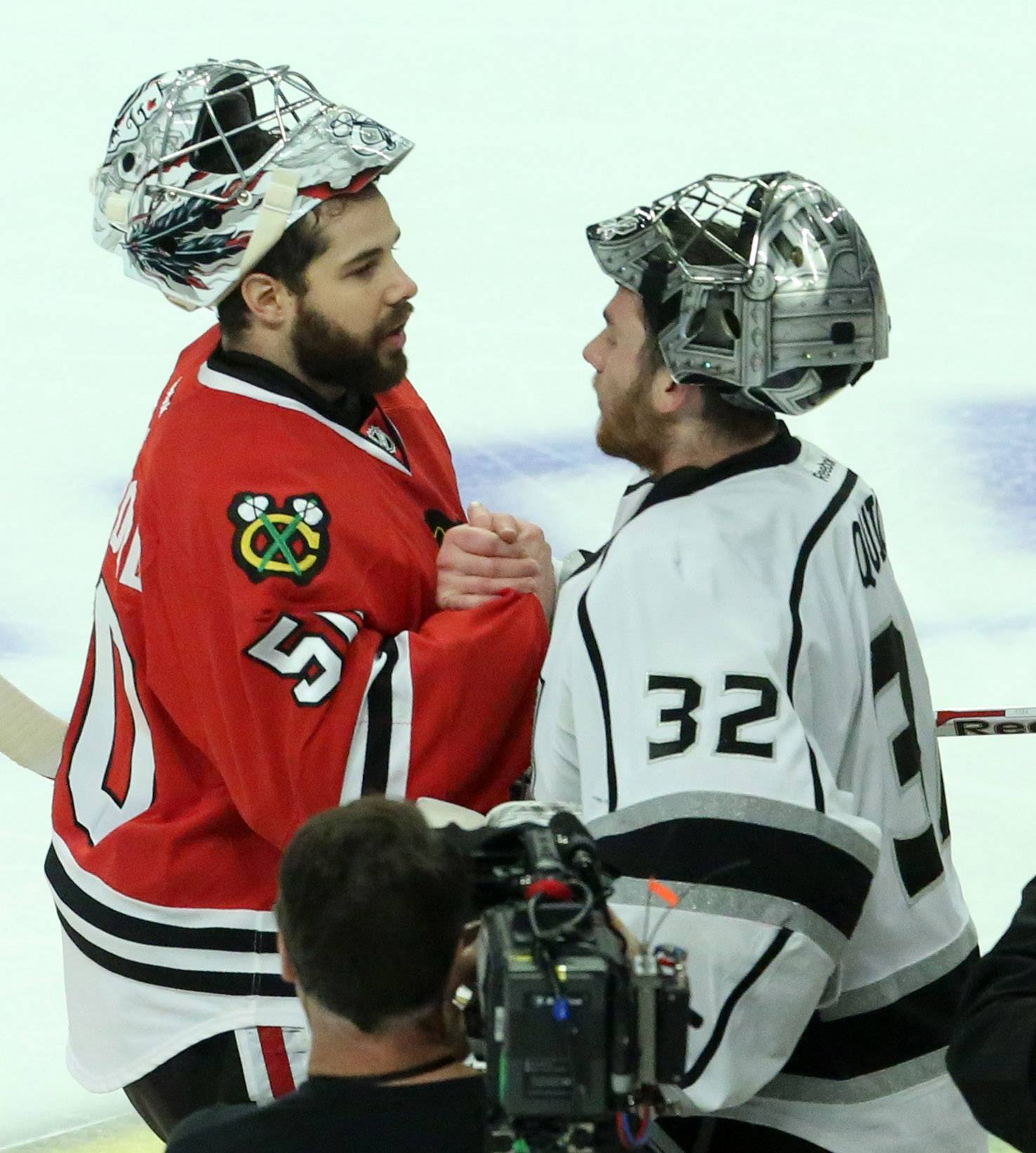 Chicago Blackhawks goalie Corey Crawford gets a handshake from Los Angeles Kings goalie Jonathan Quick after letting the winning goal past him in overtime of Game 7 as the Los Angeles Kings win the Western Conference final 5-4 on Sunday at the United Center in Chicago.