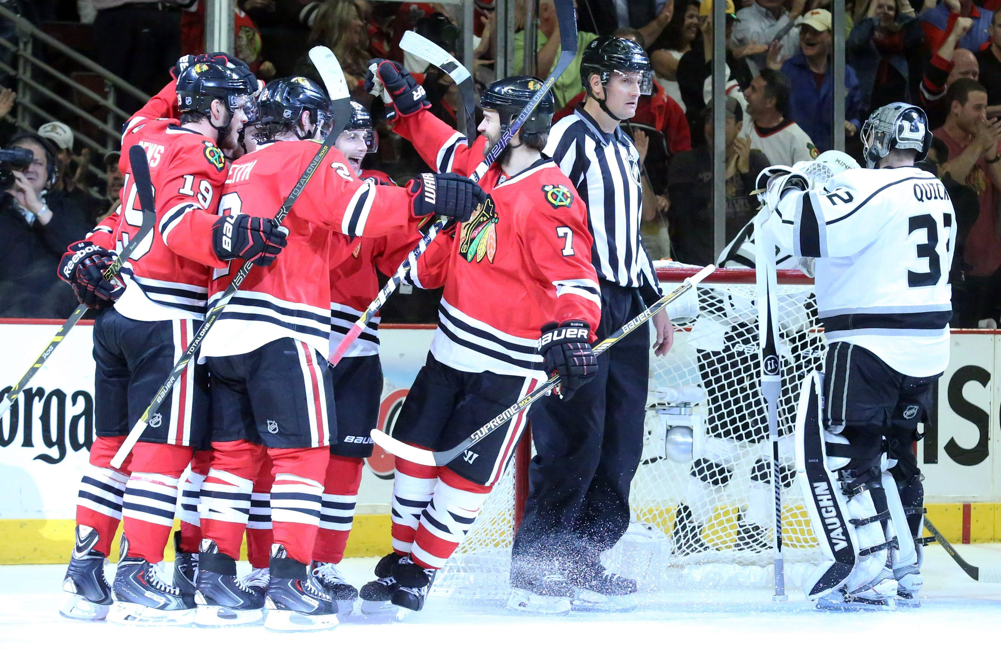 Chicago Blackhawks celebrate a goal by center Jonathan Toews in the first period in Game 7 of the Western Conference finals Sunday at the United Center in Chicago.