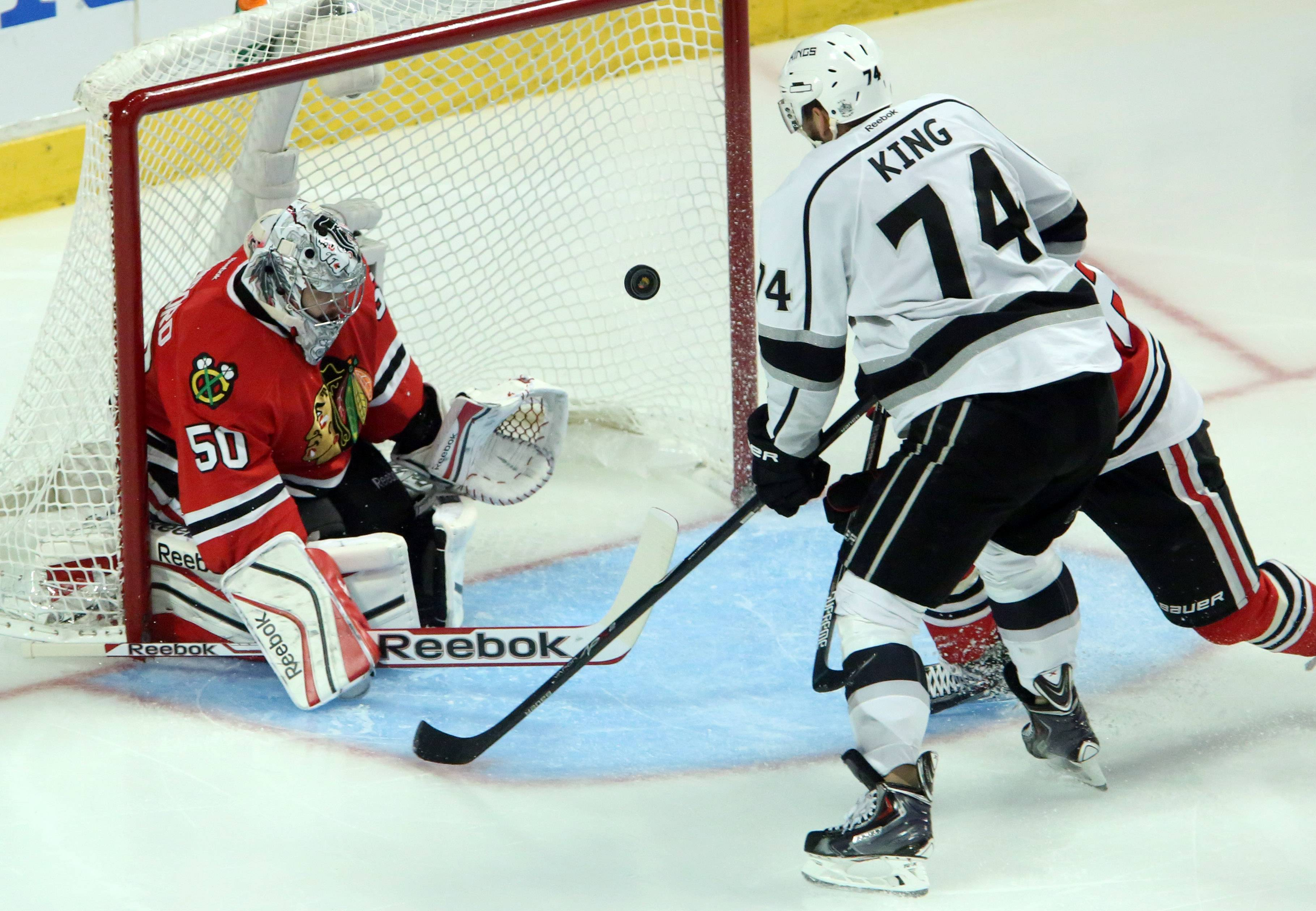 George LeClaire/gleclaire@dailyherald.com Chicago Blackhawks goalie Corey Crawford stops a shot by Los Angeles Kings left wing Dwight King in the third period of Game 7.
