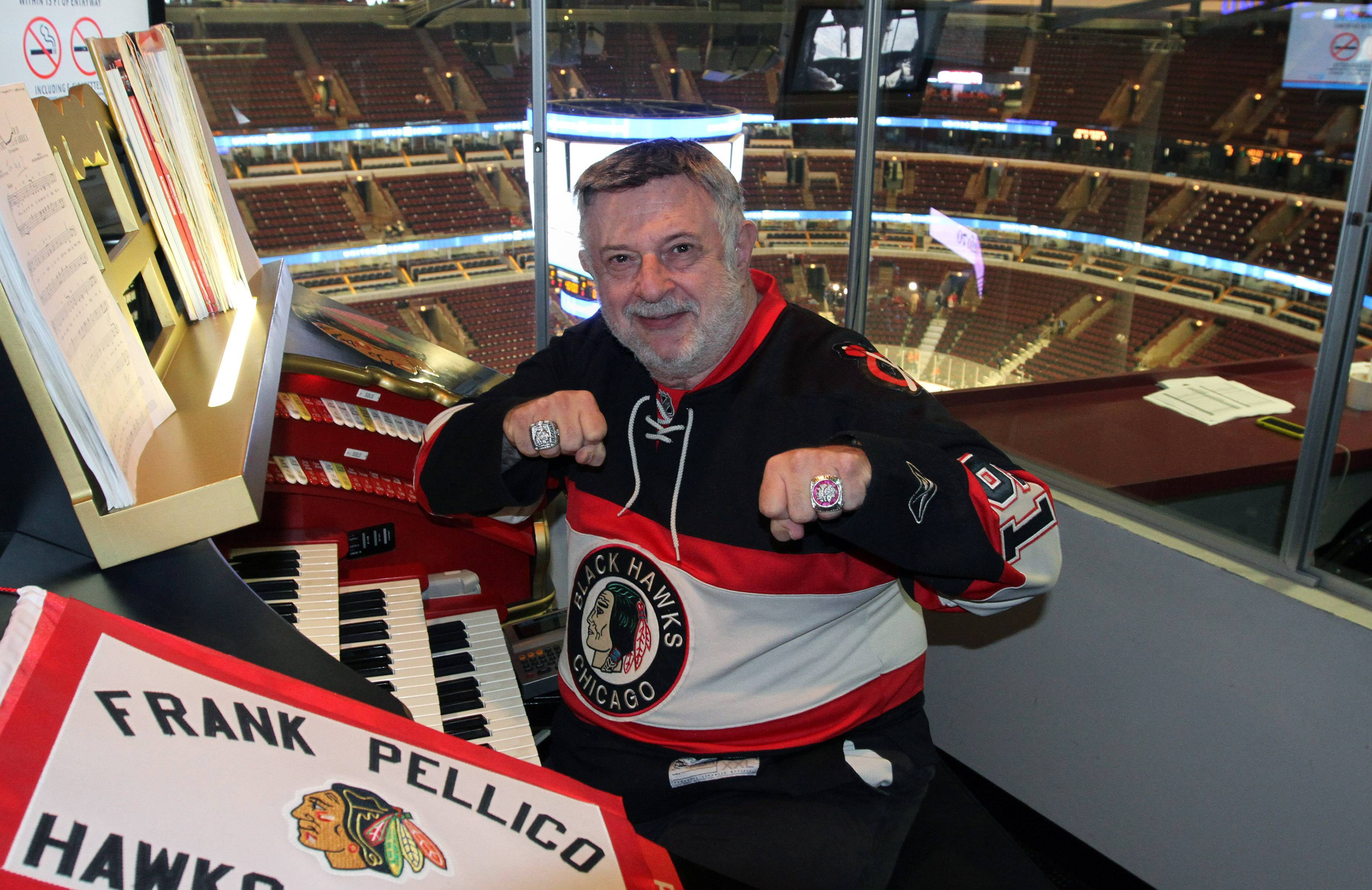 Chicago Blackhawks organist Frank Pellico shows his Stanley Cup rings before the start of Game 7 of the Western Conference finals Sunday at the United Center in Chicago.