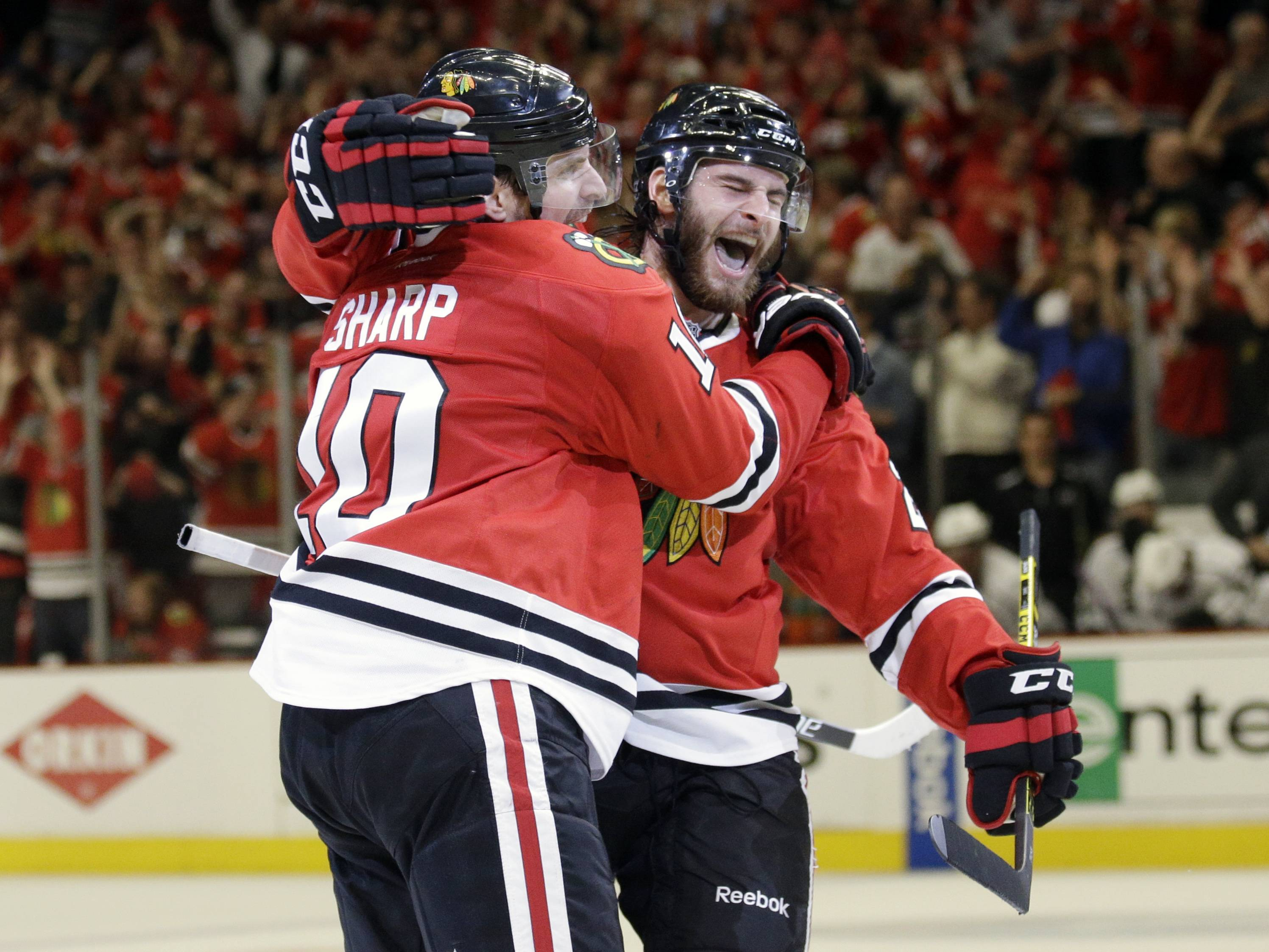 Chicago Blackhawks left wing Patrick Sharp (10) celebrates his goal with Chicago Blackhawks left wing Brandon Saad during the second period in Game 7 of the Western Conference finals in the NHL hockey Stanley Cup playoffs against the Los Angeles Kings Sunday, June 1, 2014, in Chicago.