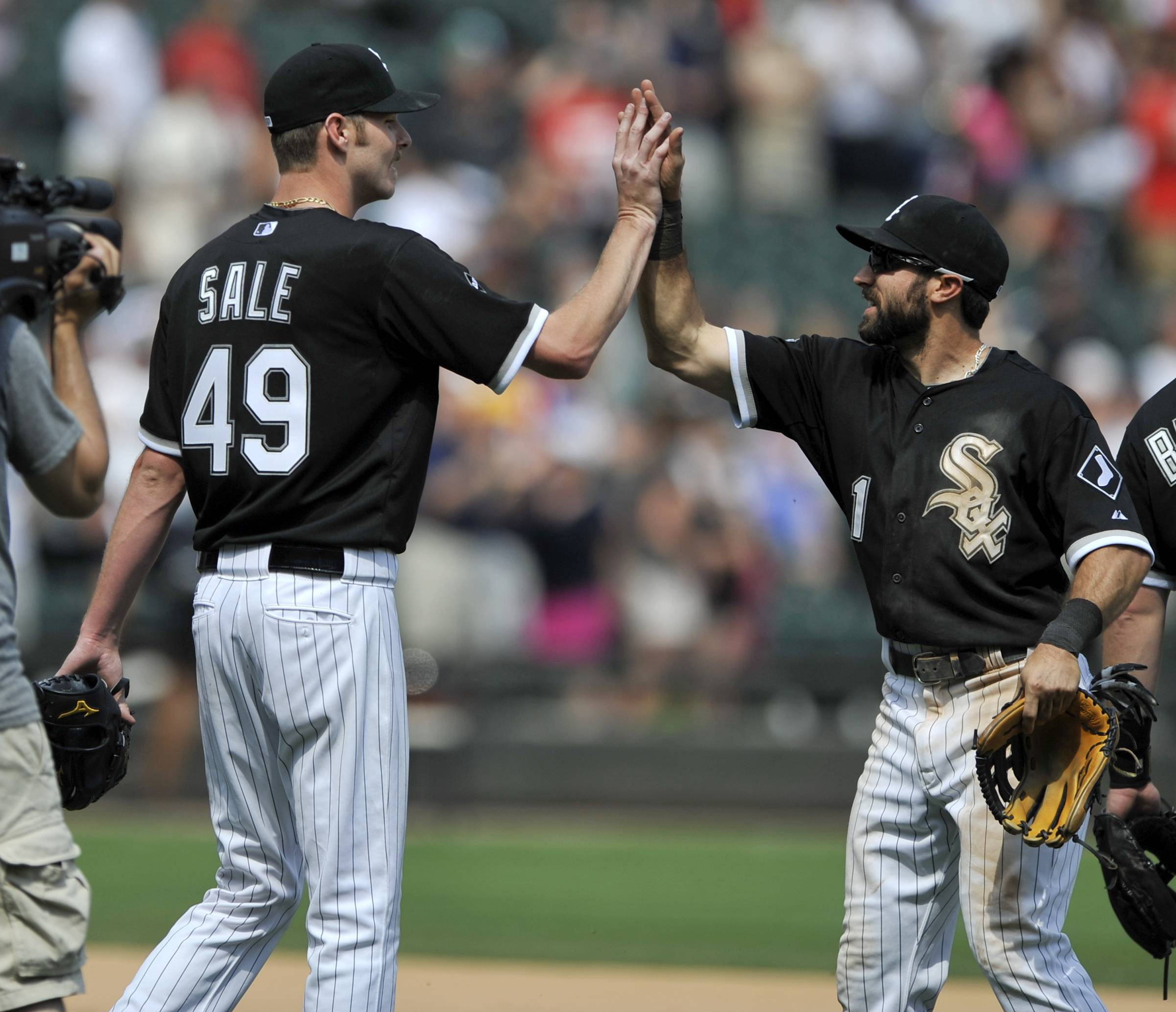 White Sox starting pitcher Chris Sale, left, celebrates with teammate Adam Eaton after going the distance Sunday. Sale allowed only 2 hits while striking out nine Padres batters.