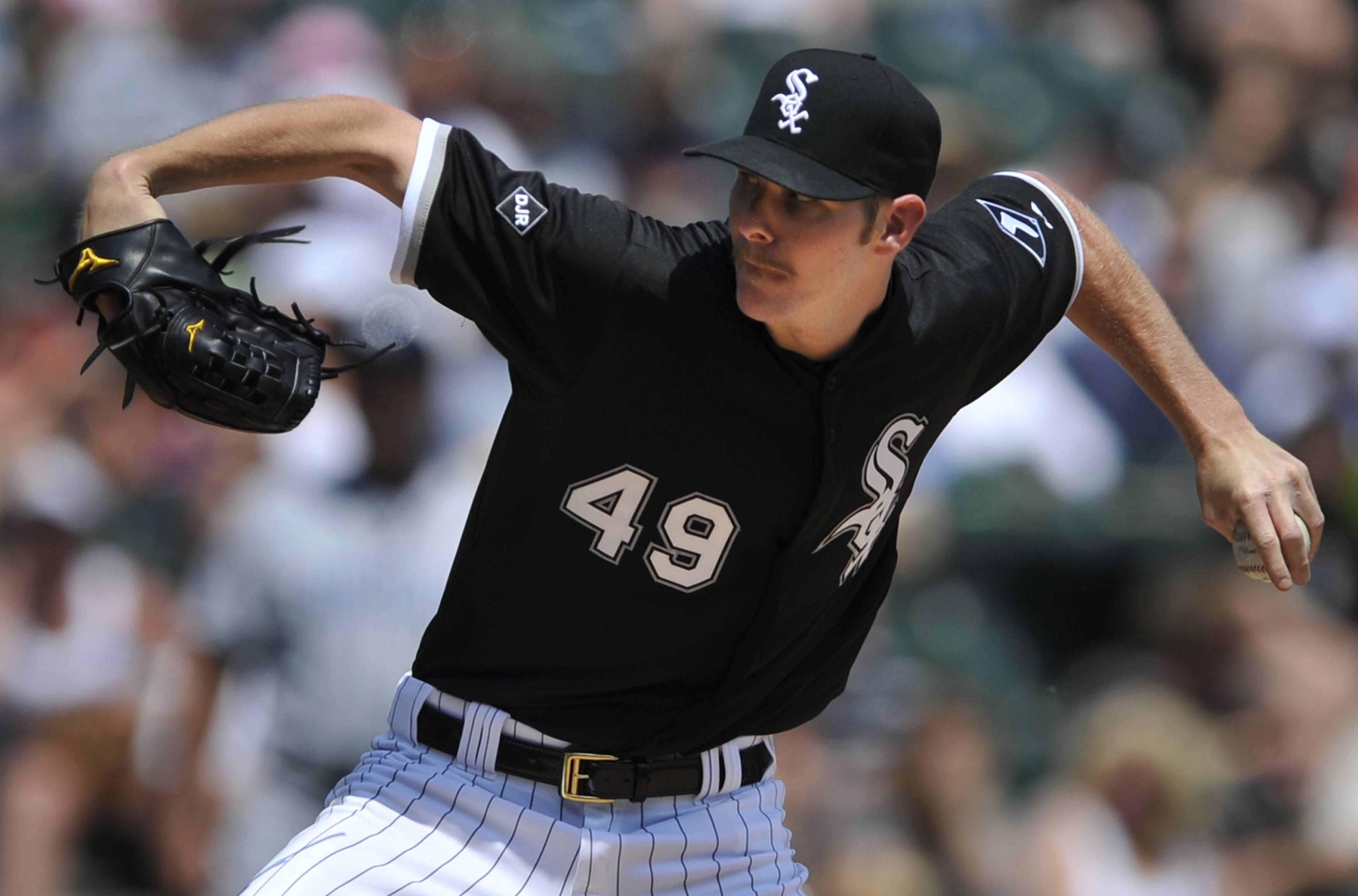 Chicago White Sox starter Chris Sale delivers a pitch during the third inning of an interleague  baseball game against the San Diego Padres in Chicago, Sunday, June 1, 2014.