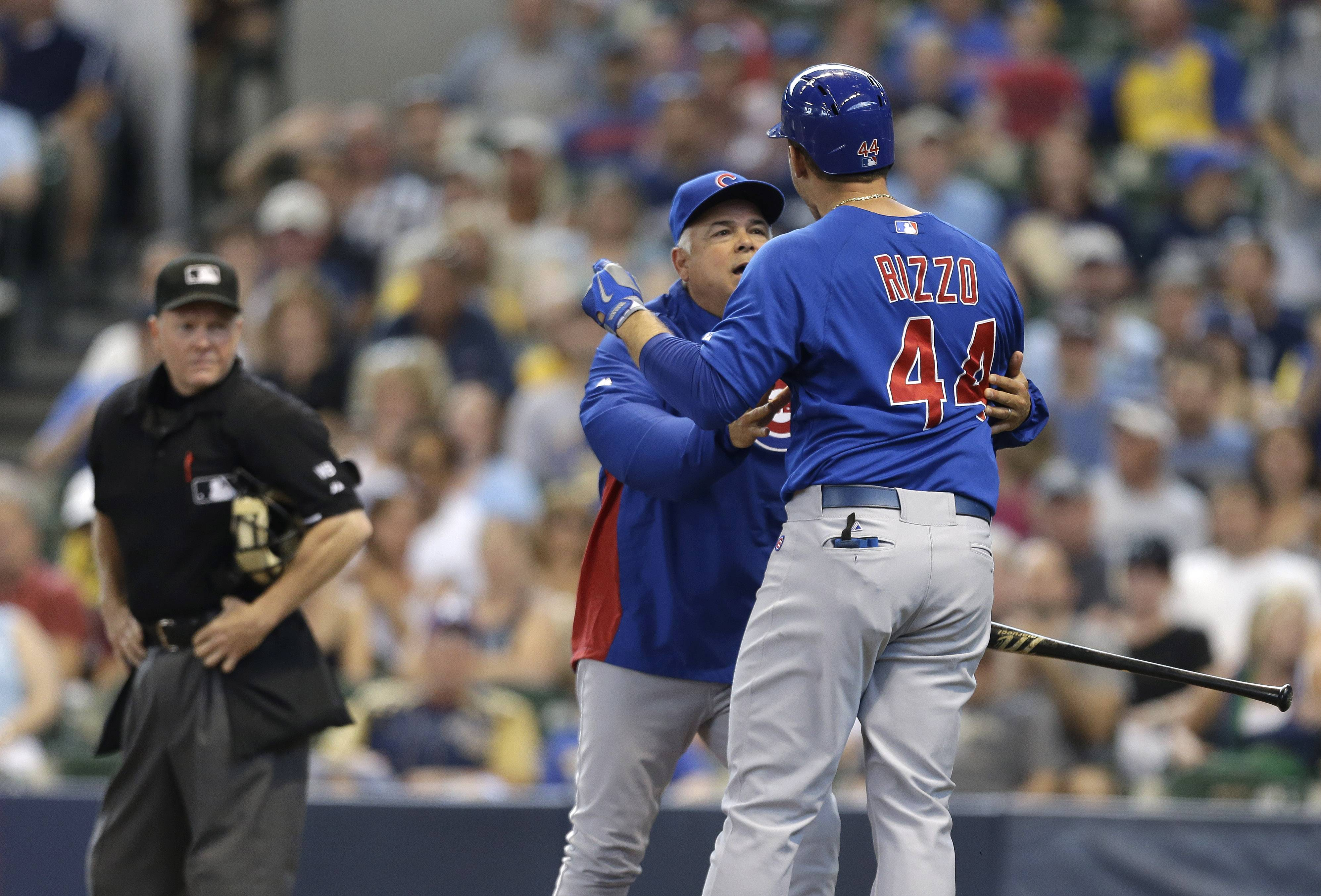 Cubs manger Rick Renteria, second from right, tries to restrain Anthony Rizzo (44) who argues with home plate umpire Jerry Meals in the fourth inning of a baseball game against the Milwaukee Brewers, Sunday, June 1, 2014, in Milwaukee. Rizzo was ejected from the game.