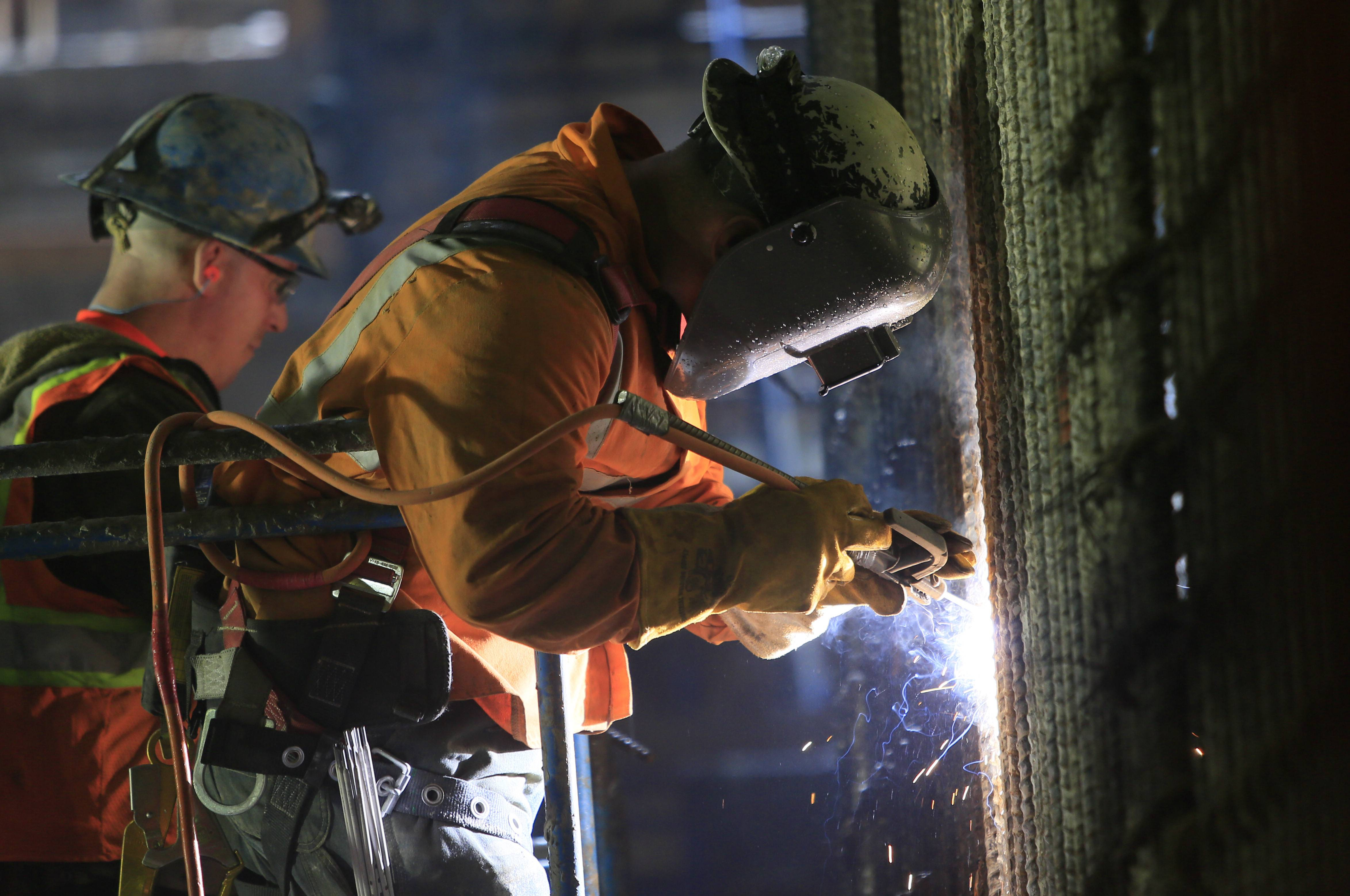 Welders connect iron support bars during construction inside the cavern of the Second Avenue subway tunnel at 86th Street, in New York. U.S. construction spending posted modest gains in April, driven by an uptick in home building and government construction that lifted total activity to the highest level in five years.