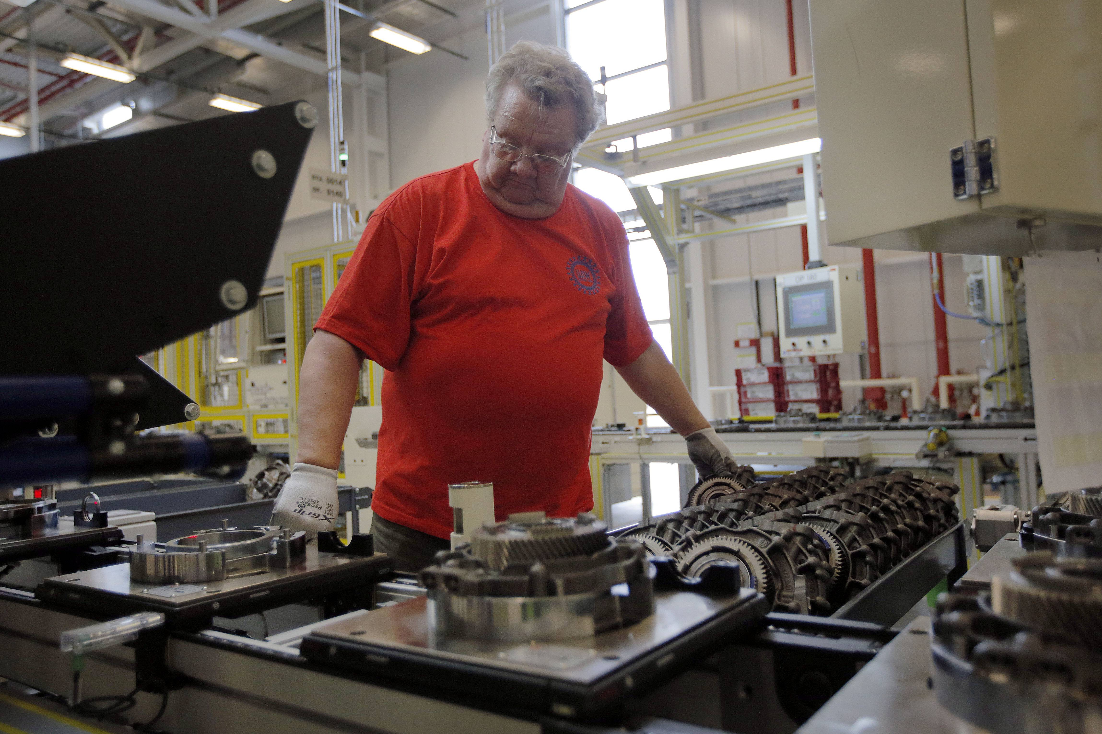 Dave Roop, of Cicero, Ind., works on the line of a Chrysler transmission manufacturing facility in Tipton, Ind. U.S. manufacturers grew at a slower pace in May as measures of orders and production fell. Factories also added jobs at a slower pace.
