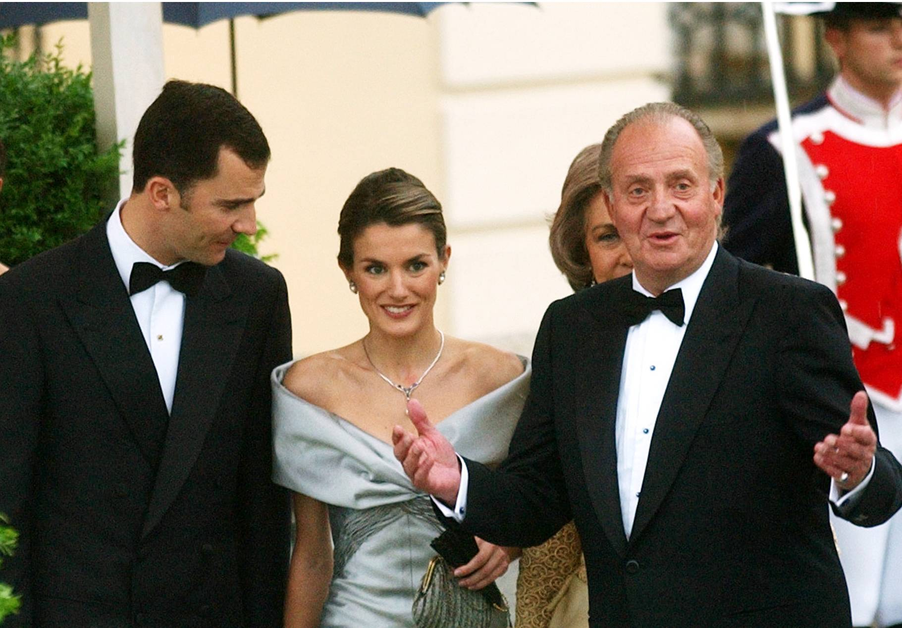 Spain's Princess Letizia and Prince Felipe aer seen a day before their wedding day with King Juan Carlos, right, in Madrid on May 21, 2004. Carlos plans to abdicate and pave the way for his son, Felipe, to become the country's next king.