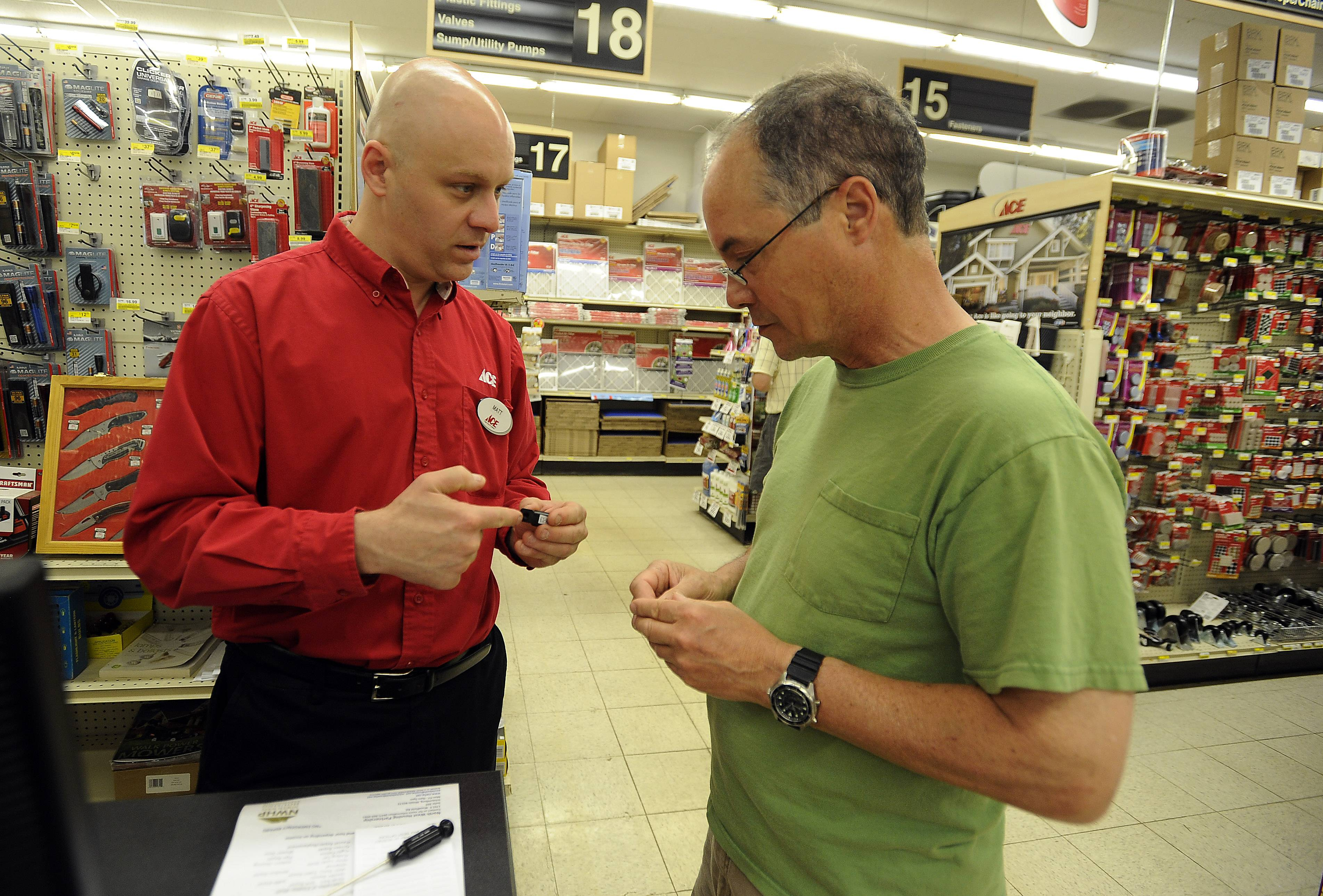 Sherwin Ace Hardware owner Matt Hanson in Arlington Heights helps out customer Steve Tiberi with an electrical problem. Hanson became the owner Jan. 1, taking over from Bob Ward.