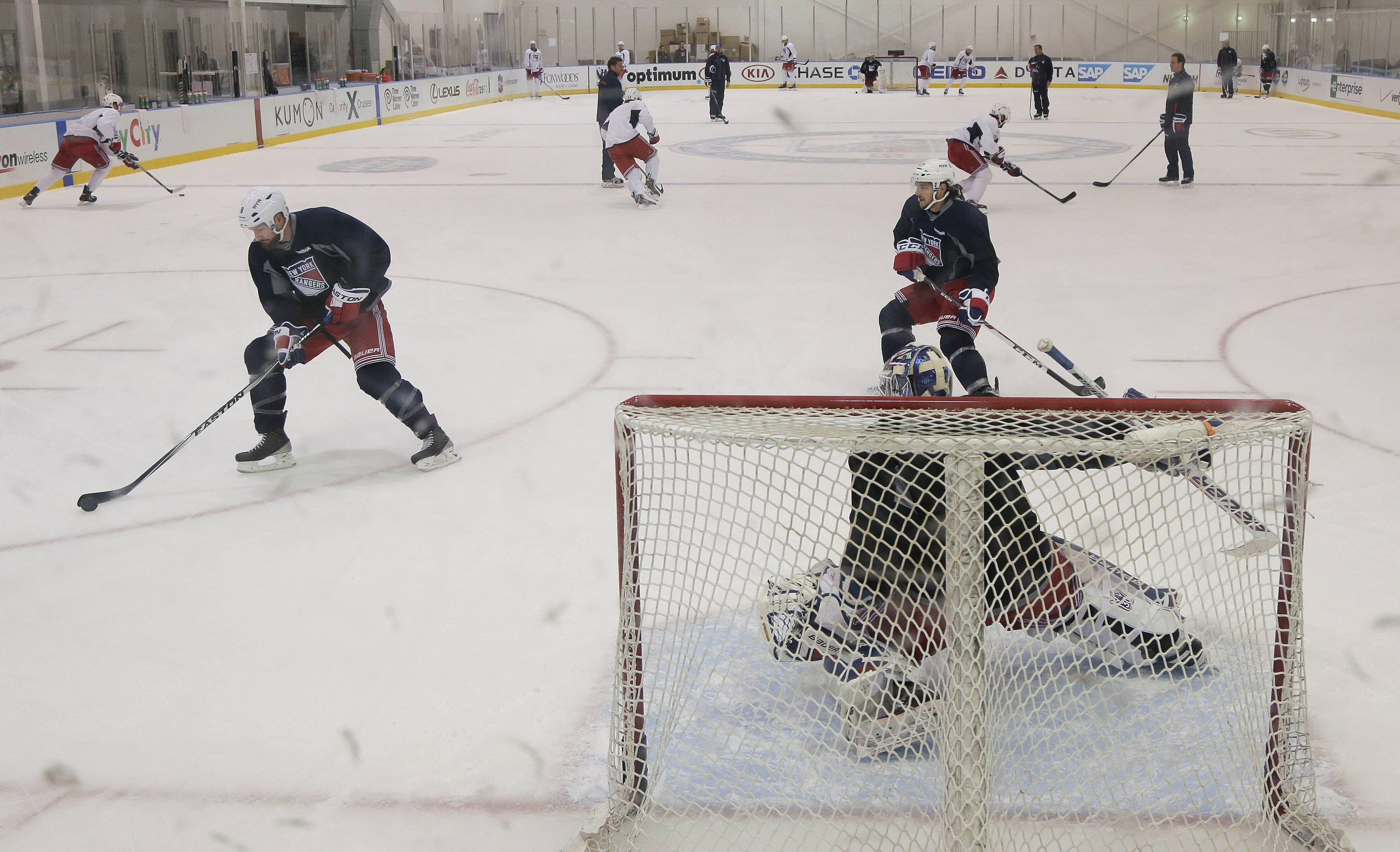 The New York Rangers run through drills at their practice facility, Monday in Greenburgh, N.Y. The Rangers will face the Los Angeles Kings in Game 1 of Stanley Cup Final in Los Angeles on Wednesday.