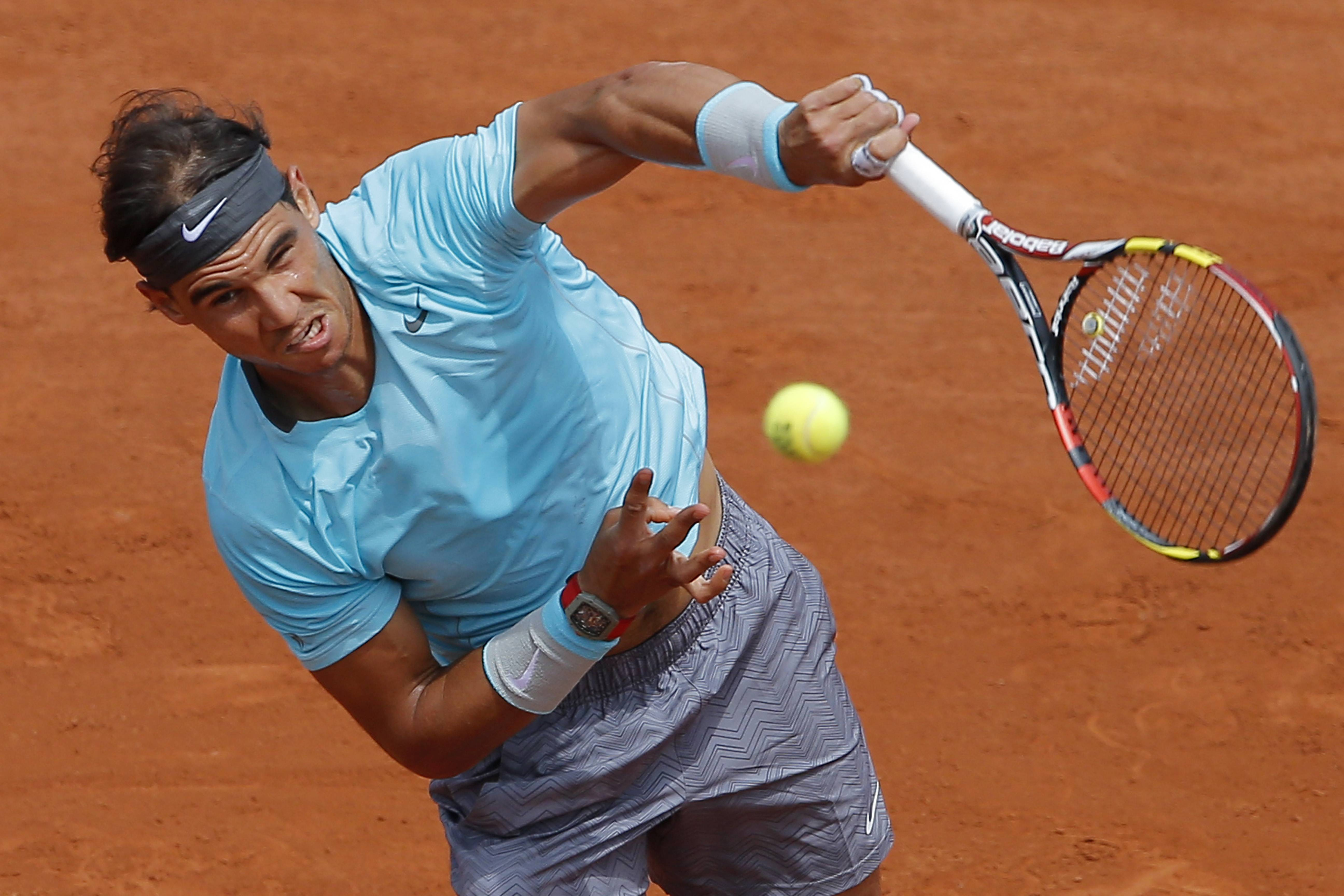 Spain's Rafael Nadal serves the ball Monday during the fourth round match of the French Open tennis tournament against Serbia's Dusan Lajovic at the Roland Garros stadium in Paris.