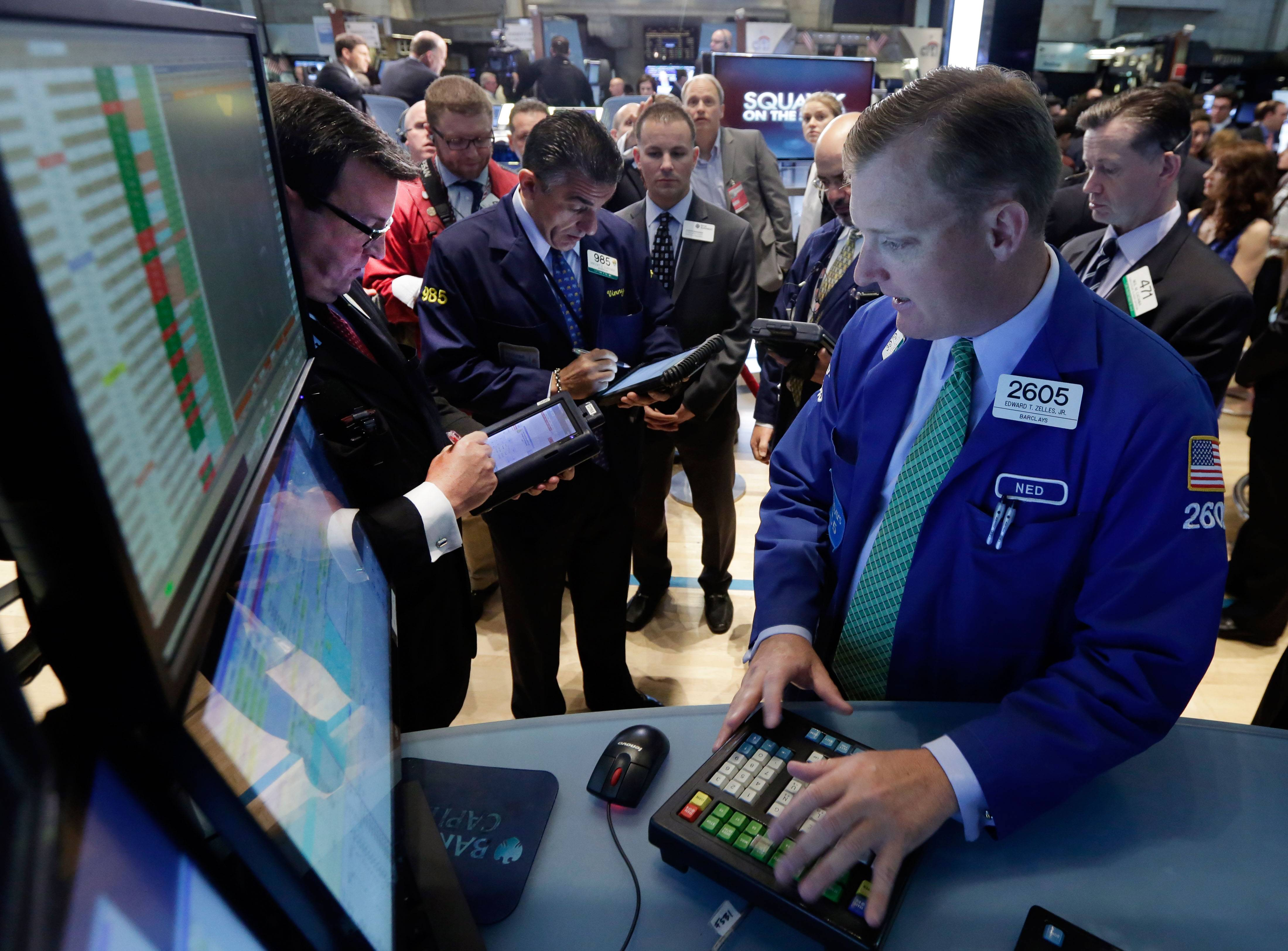 Stocks closed mostly higher on a quiet Monday following two reports that showed the manufacturing industries of the world's two largest economies expanded last month. Both the Dow Jones industrial average and the Standard & Poor's 500 index were able to set record highs for a second trading day in a row.