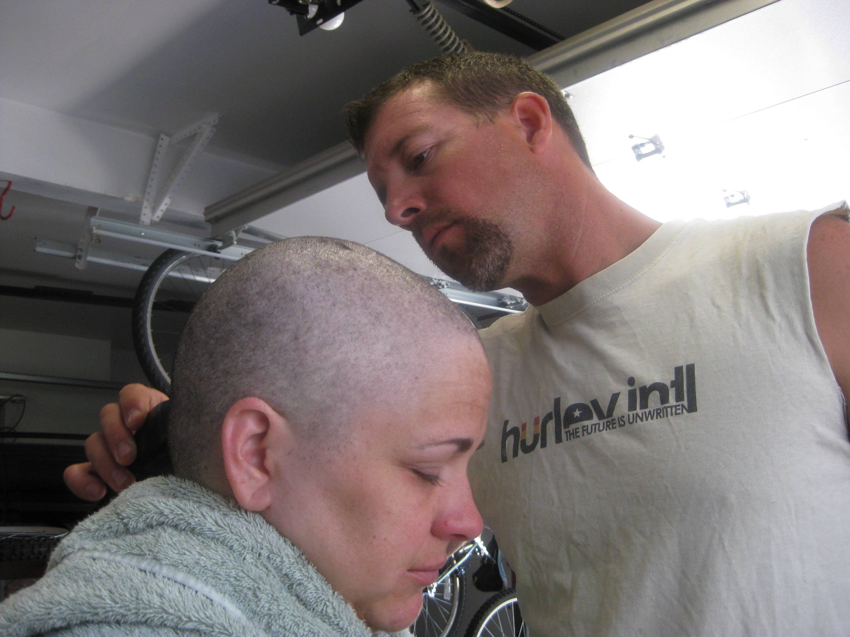 "Matthew Wallace shaves his wife's head when her hair was falling out in August 2012. Arrica Wallace was 35 when her cancer was discovered in 2011. It spread widely, with one tumor so large that it blocked half of her windpipe. The strongest chemotherapy and radiation failed to help, and doctors gave her less than a year to live. But her doctor heard about an immune therapy trial at the Cancer Institute and got her enrolled. ""It's been 22 months since treatment and 17 months of completely clean scans"" that show no sign of cancer, Arrica Wallace said."