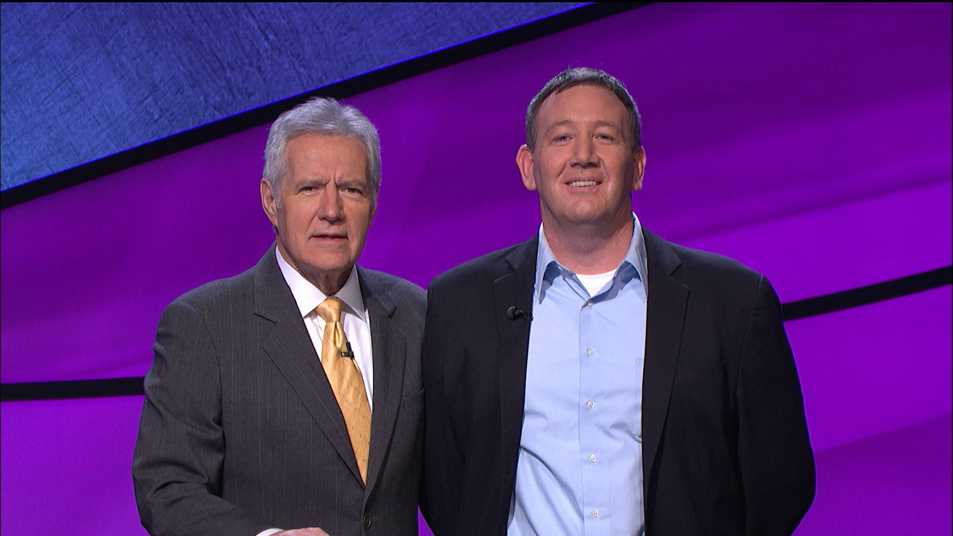 "Alex Trebek, left, host of the TV show ""Jeopardy!,"" poses with contestant Brian Loughnane, an investment operations manager from Scituate, Mass., who ended Julia Collins' 20-game winning streak."