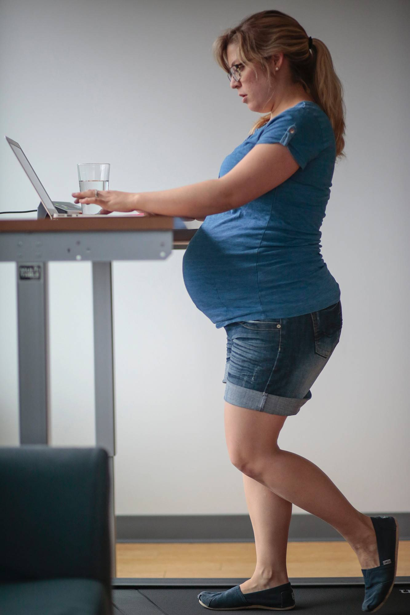 In addition to standing desks, Opower offers employees like Julie O'Brien, who's in her 39th week of pregnancy, two treadmill workstations.