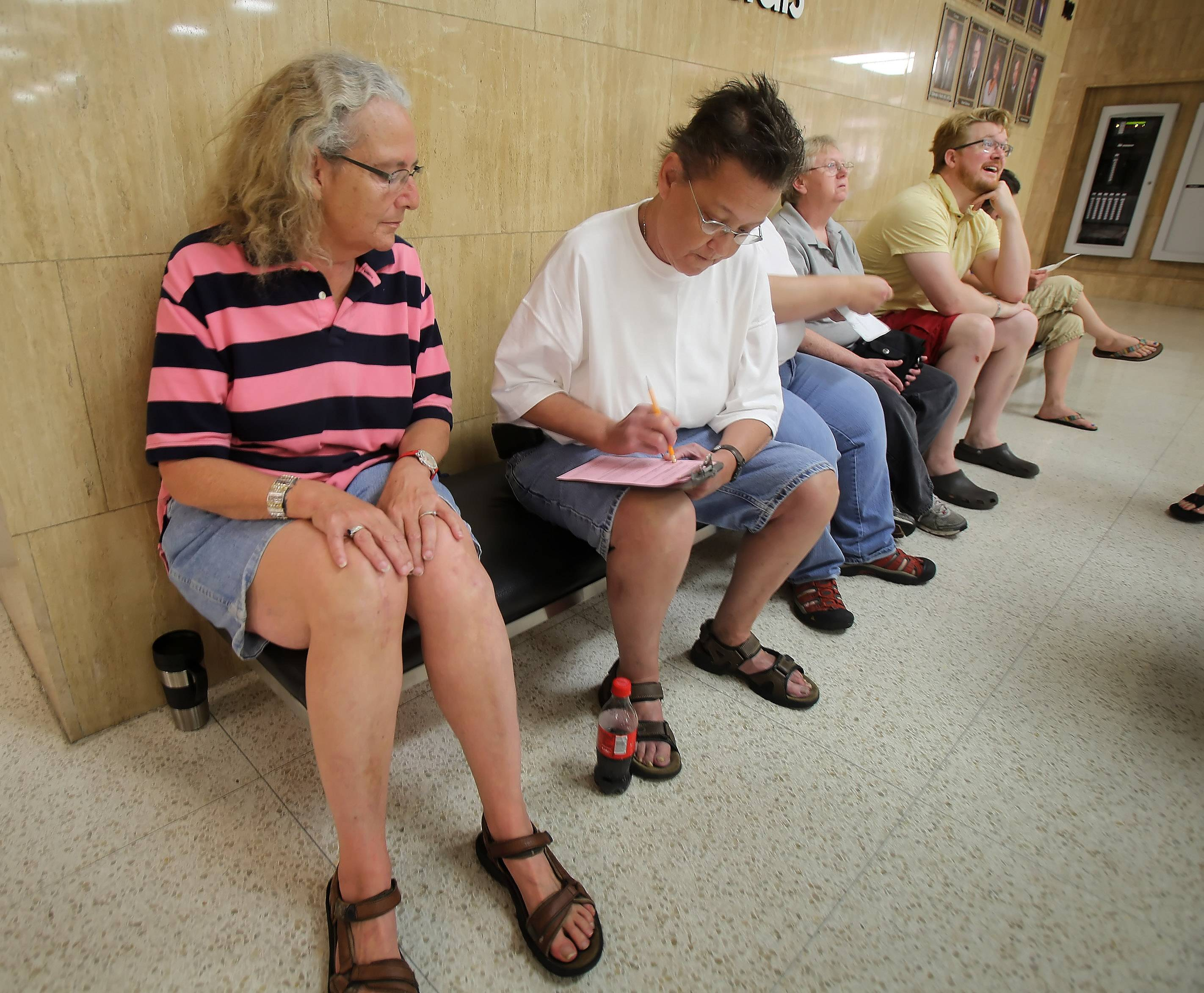 LaDean Lines and Beth Kelley of Waukegan fill out paperwork as they are first in line for a same-sex marriage license at the Lake County Clerk's office in Waukegan.
