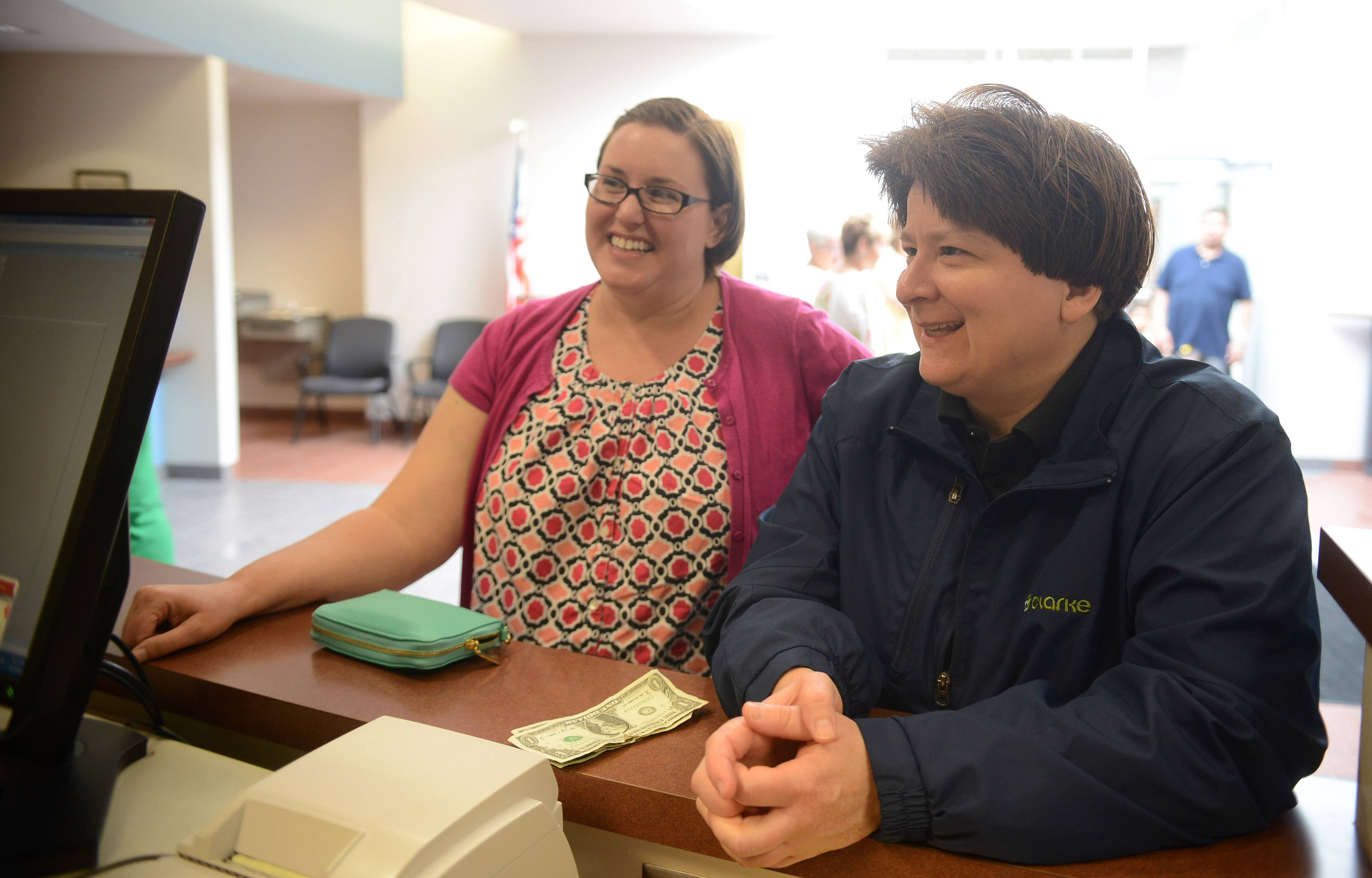 Traci Simon, left, and Michelle Selander smile while answering questions so they can receive their marriage license at the Kane County Clerk's office Monday morning in Geneva. They live in South Elgin and are planning to be married Saturday in Geneva.
