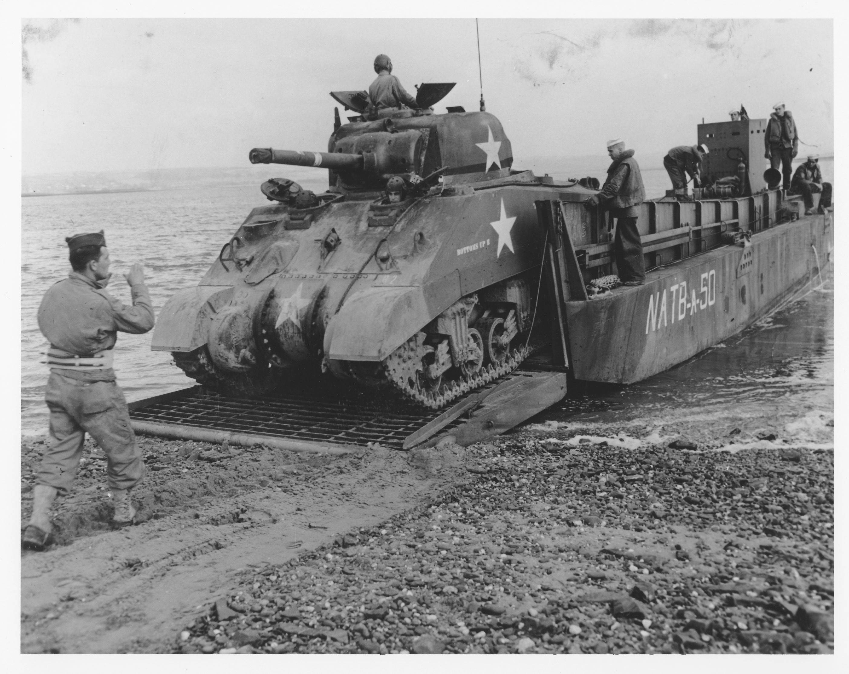 A Sherman tank of Company B, 745th Tank Battalion, is loaded onto a LCM, in preparation for the Normandy Invasion. The photograph is from Sgt. Bill Moreland of Chicago.