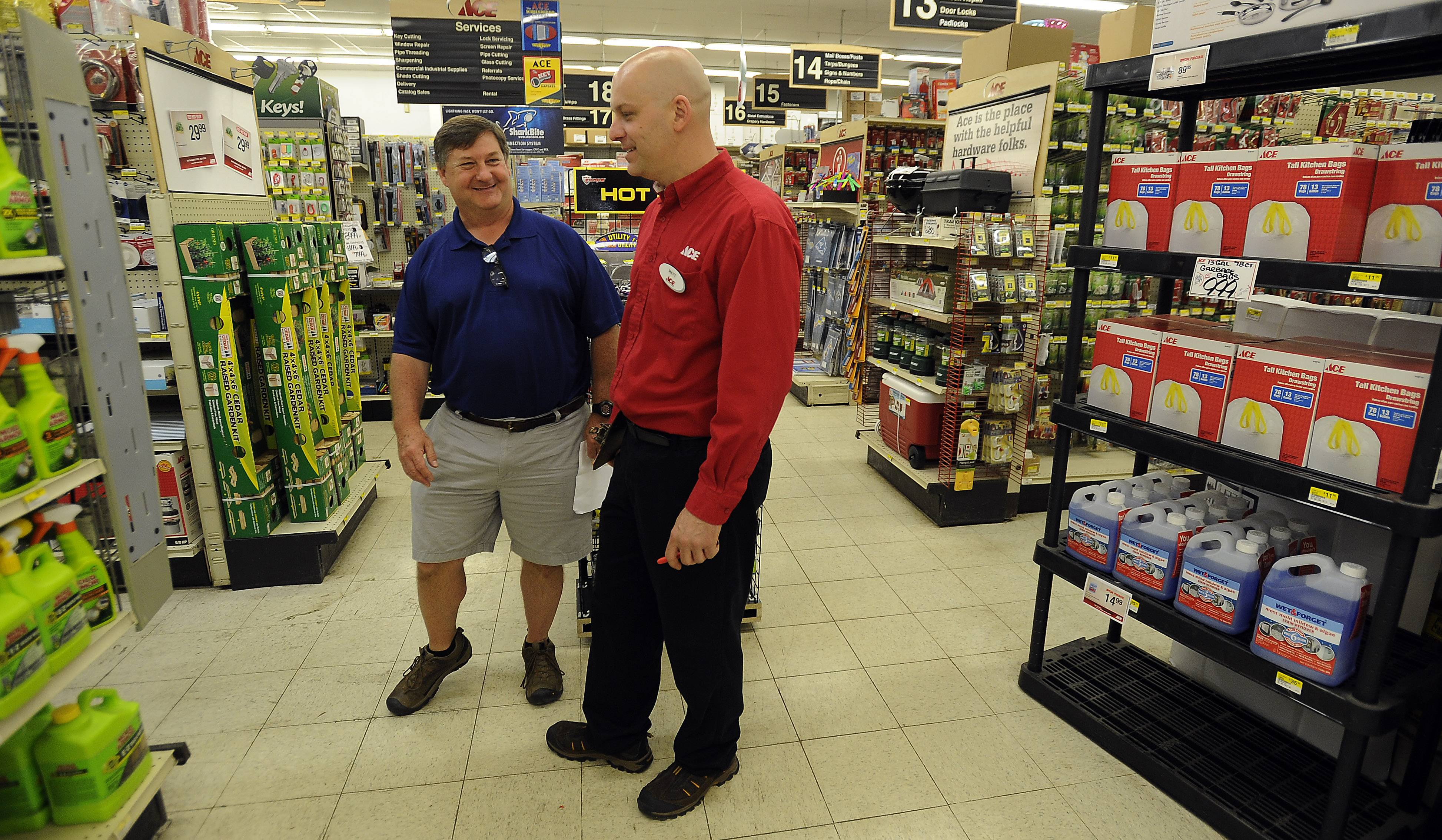 Sherwin Ace Hardware owner Matt Hanson, right, talks with former owner Bob Ward. Hanson was Ward's first hire after he bought the store in 1988.