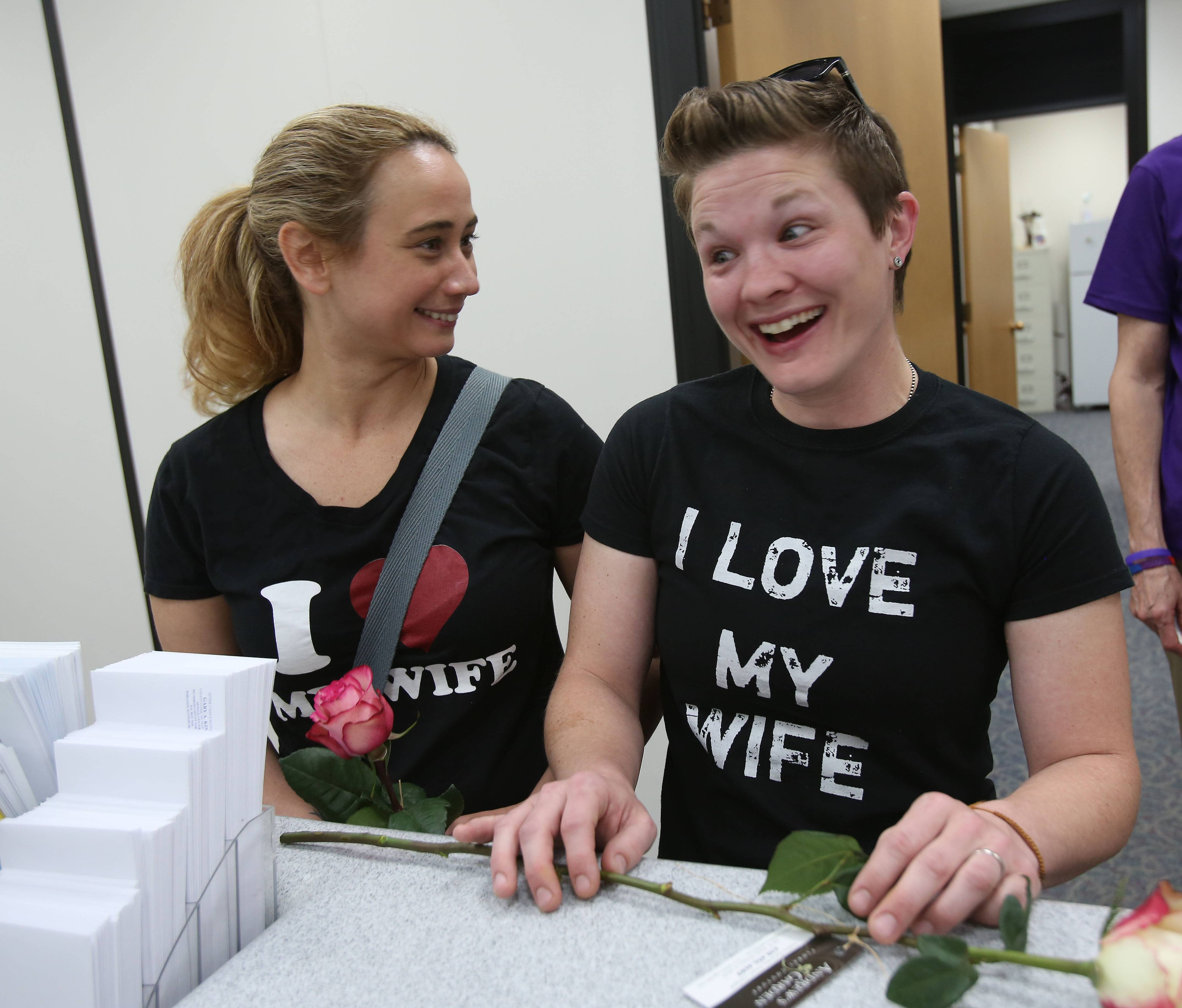 Alicia Atkinson, left and Laurin Fabry, right, of Eola, are happy to convert their civil union to a marriage license Monday at the DuPage County Clerk's office in Wheaton.