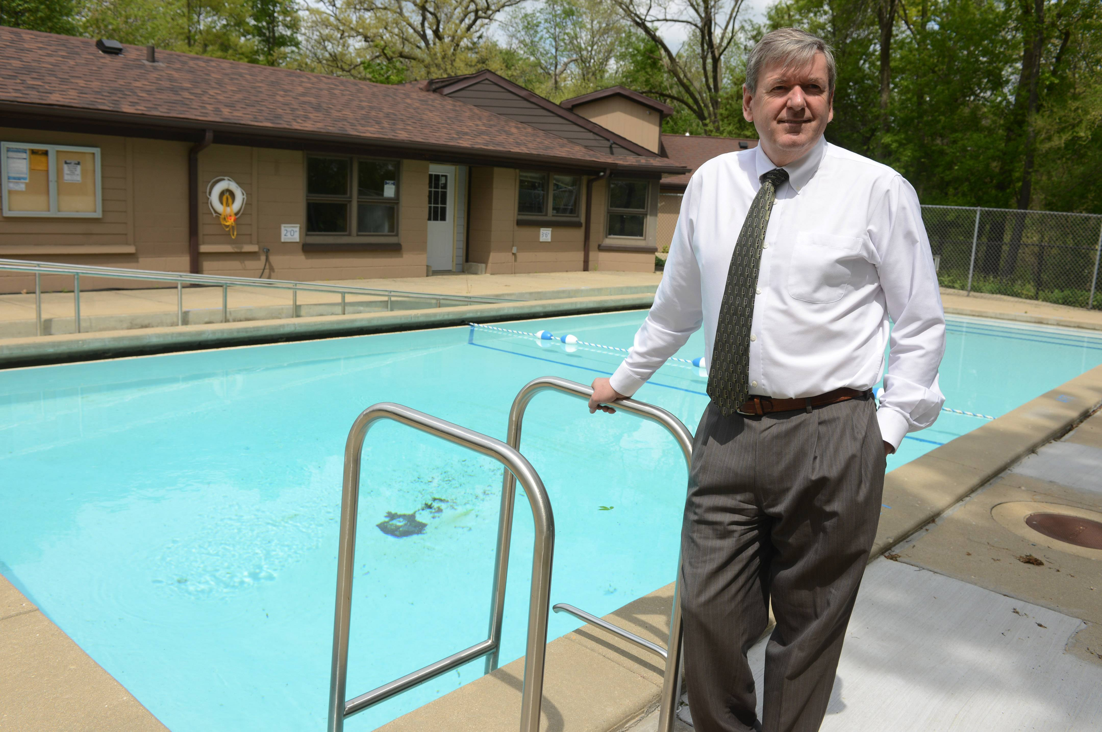 Lake Villa Township Supervisor Dan Venturi near Camp Peacock's pool, which is one of the highlights of the renovated facility.