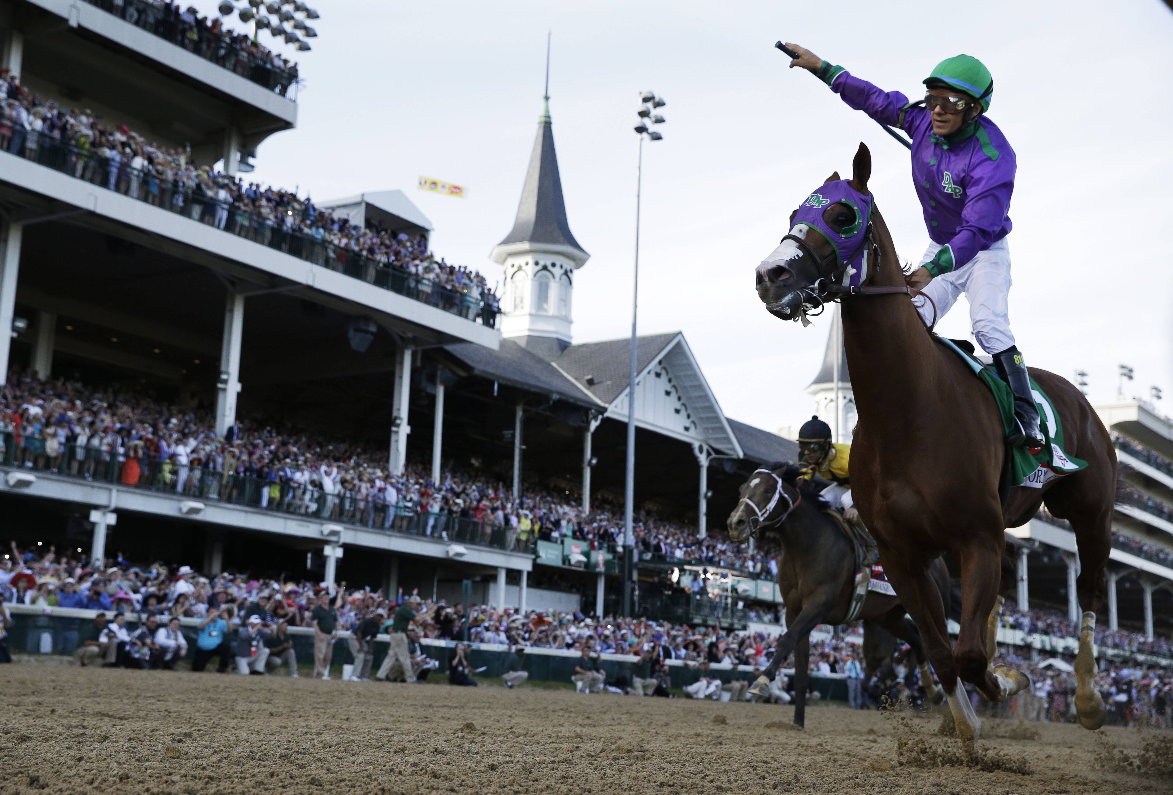 In this May 3, 2014 file photo, Victor Espinoza rides California Chrome to victory during the 140th running of the Kentucky Derby horse race at Churchill Downs in Louisville, Ky. California Chrome's bid to become racing's first Triple Crown winner in 36 years isn't scaring away the competition.