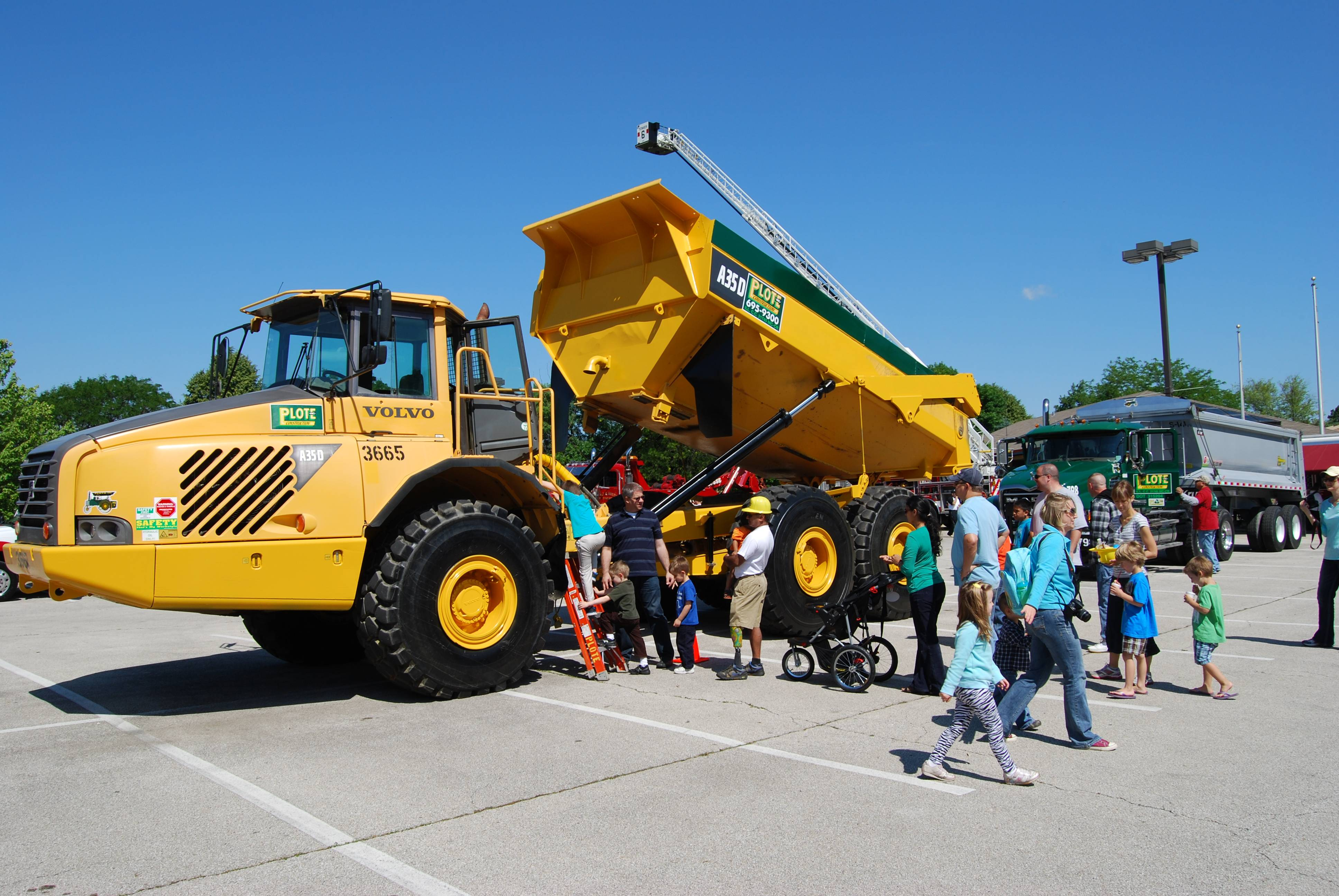 Families enjoying the 2013 Touch-A-Truck event in West Chicago.City of West Chicago