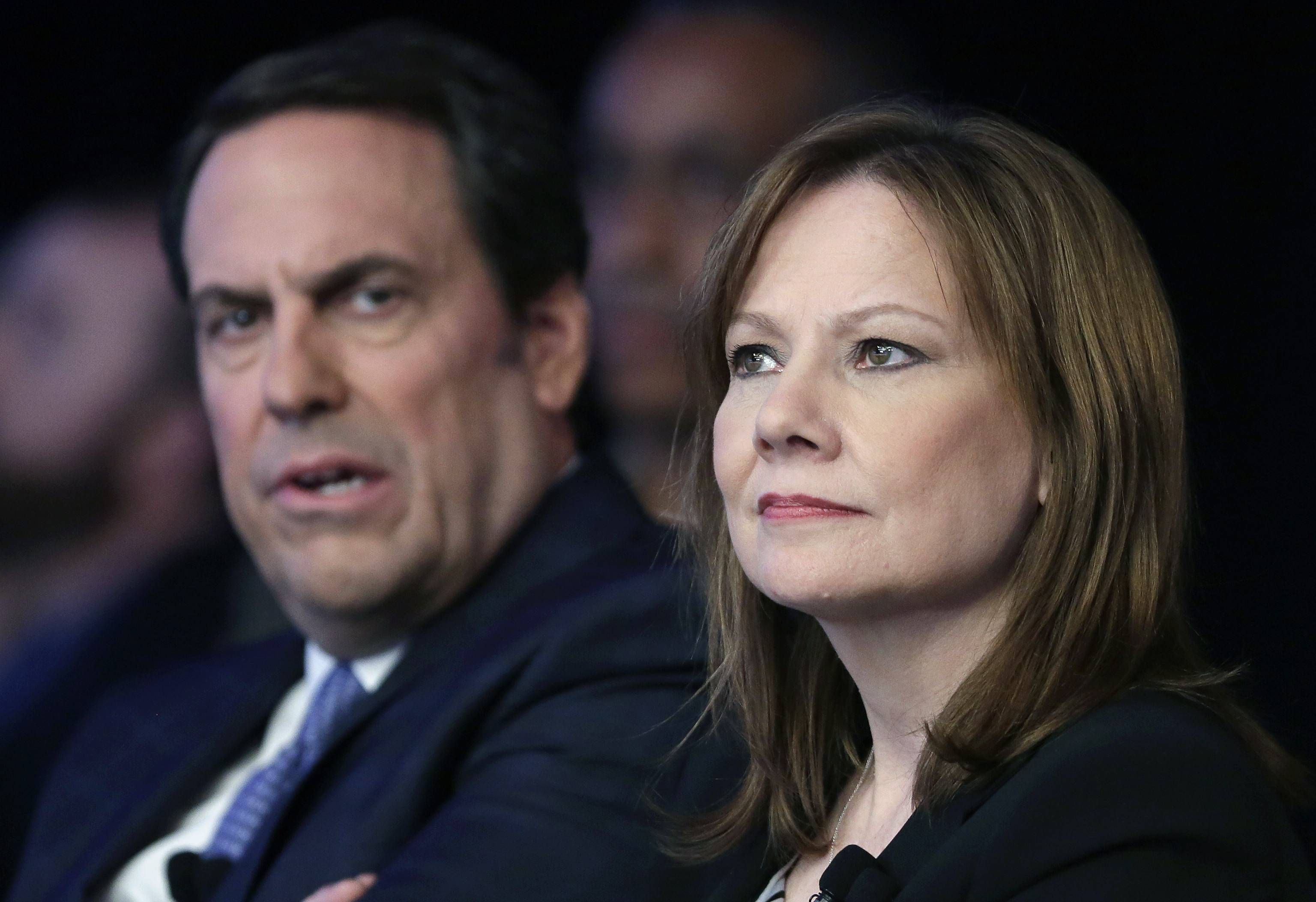 Mary Barra, CEO of General Motors, right, and Mark Reuss, executive vice president of Global Product Development for GM and President of GM America, watch the introduction of new Chevrolet cars at the New York International Auto Show April 15. GM's corporate structure — as well as what Barra has called a culture that valued cost-savings over safety — will likely be a prime target in a report expected this week from former U.S. Attorney Anton Valukas.