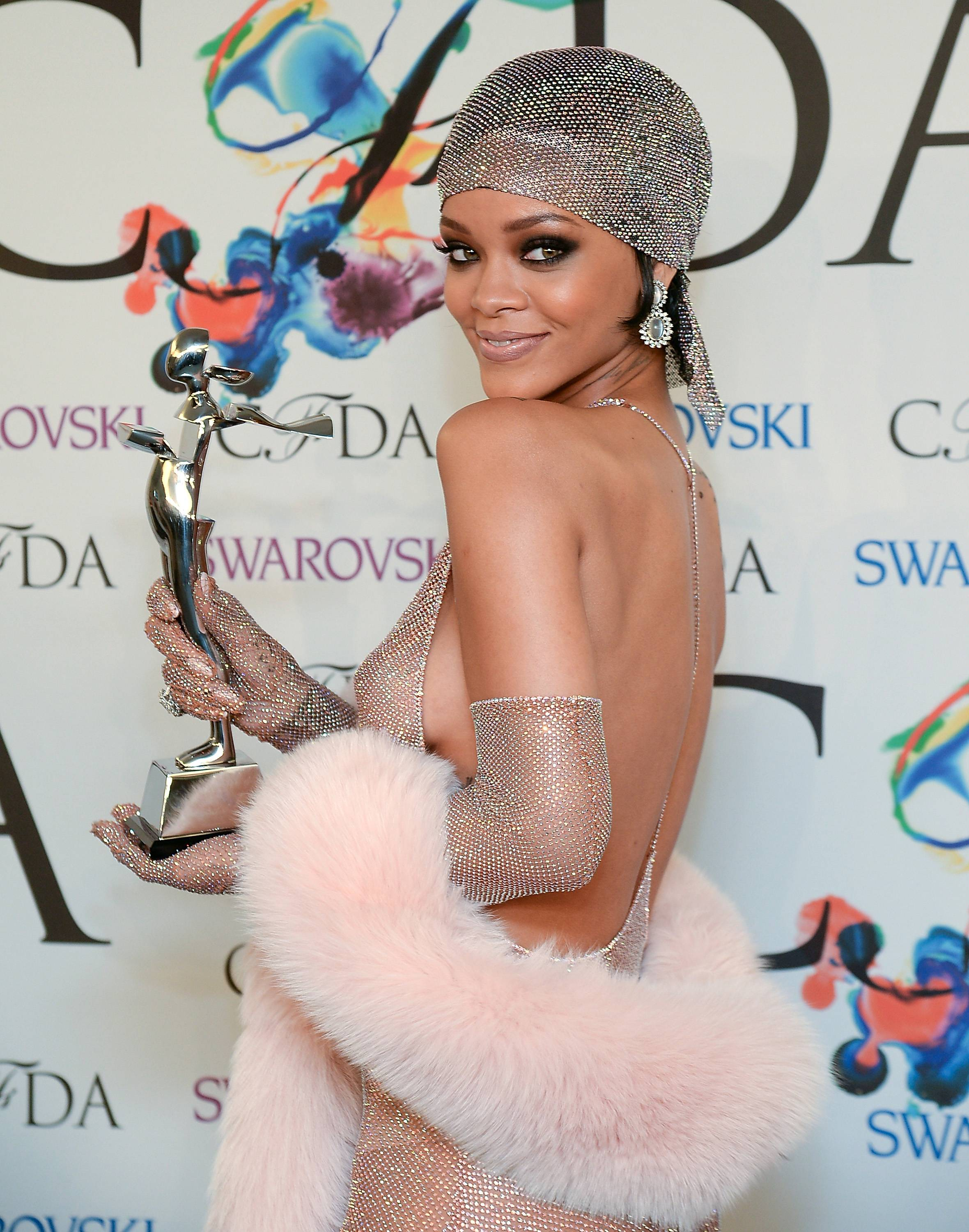 Fashion Icon Award honoree Rihanna poses with her award at the 2014 CFDA Fashion Awards at Alice Tully Hall on Monday, June 2, 2014, in New York.