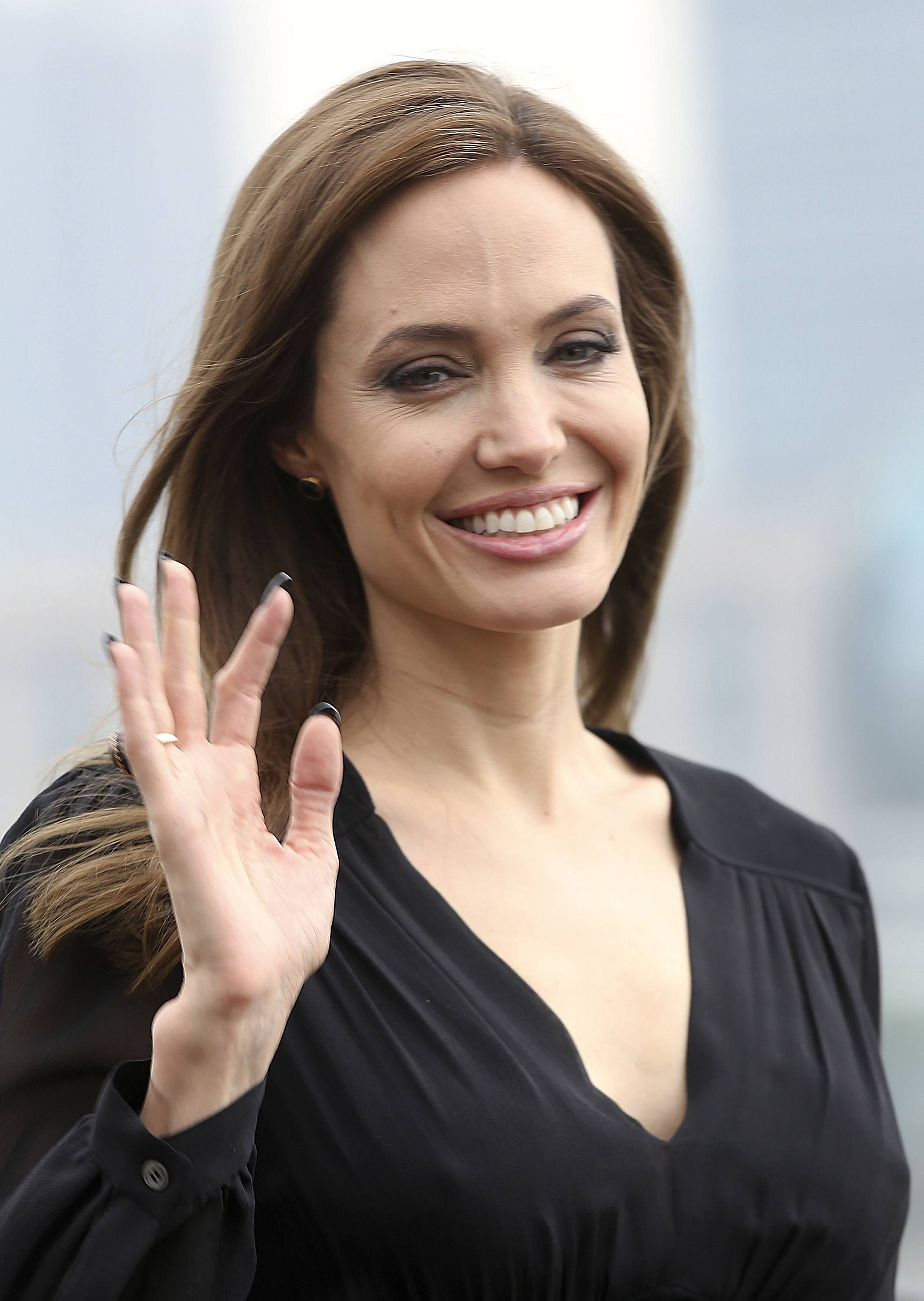 "Actress Angelina Jolie waves as she arrives at a promotion event for her movie ""Maleficent"" in Shanghai, China Tuesday, June 3, 2014."