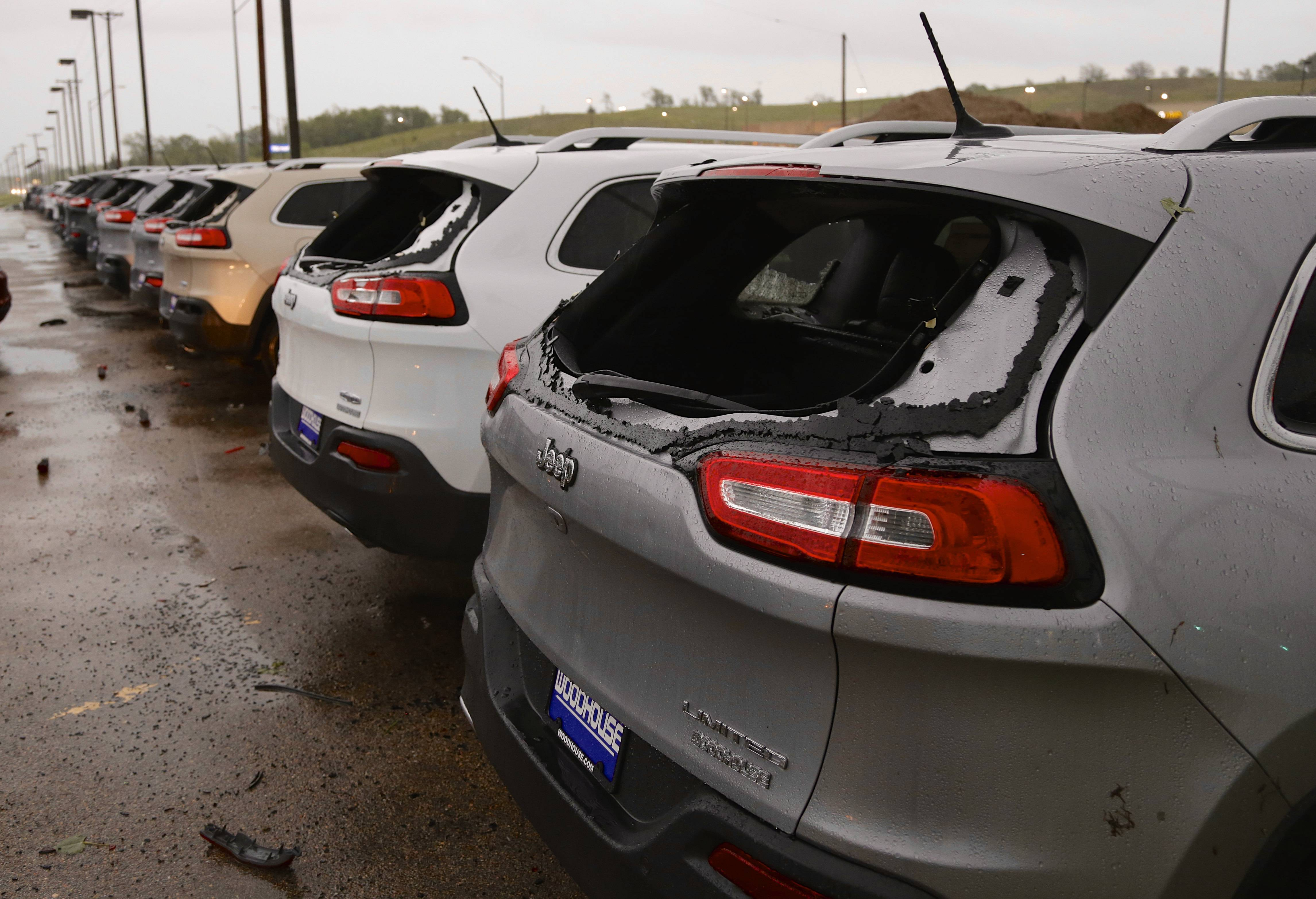 Car windows are blown out at a car dealership in Blair, Nebraska, following a severe thunderstorm. Storms packing large hail and heavy rain rolled into Nebraska and Iowa on Tuesday.
