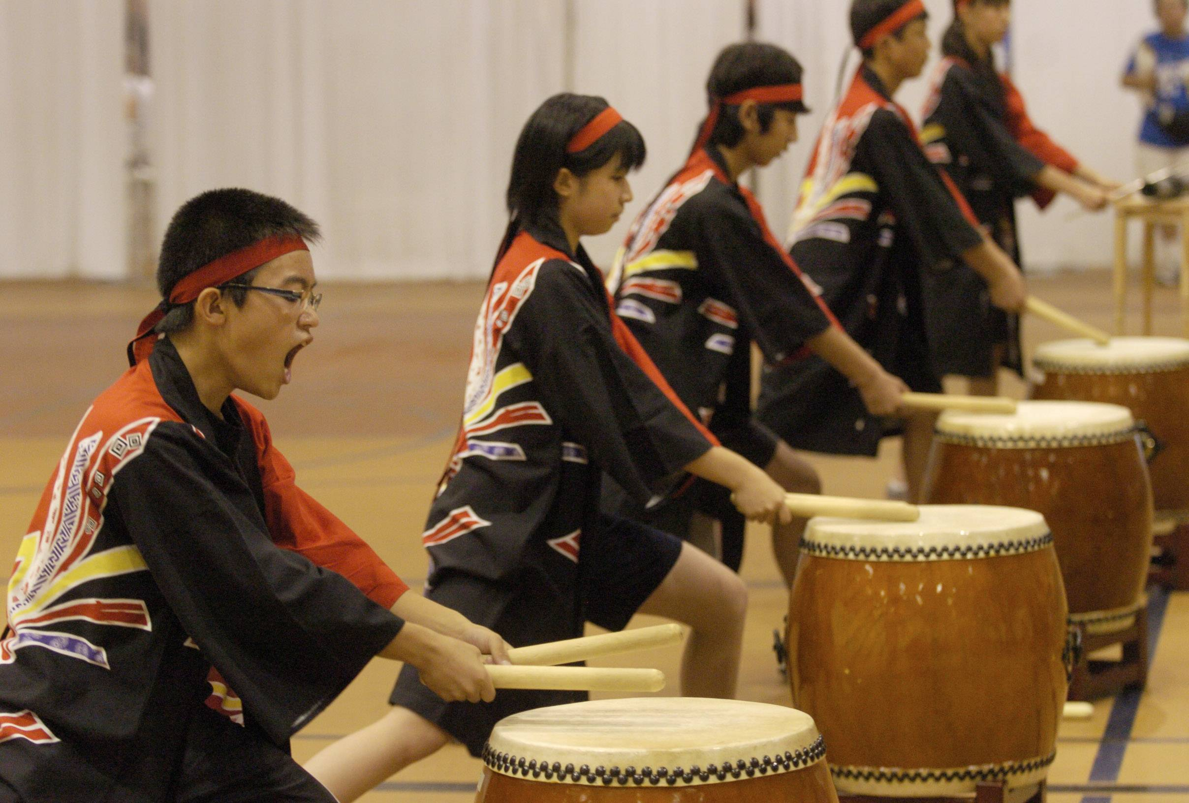JOE LEWNARD/jlewnard@dailyherald.com Yuki Kunishina of Hoffman Estates performs on the Taiko Japanese drum during the 2010 Japan Festival at the Forest View Educational Center.