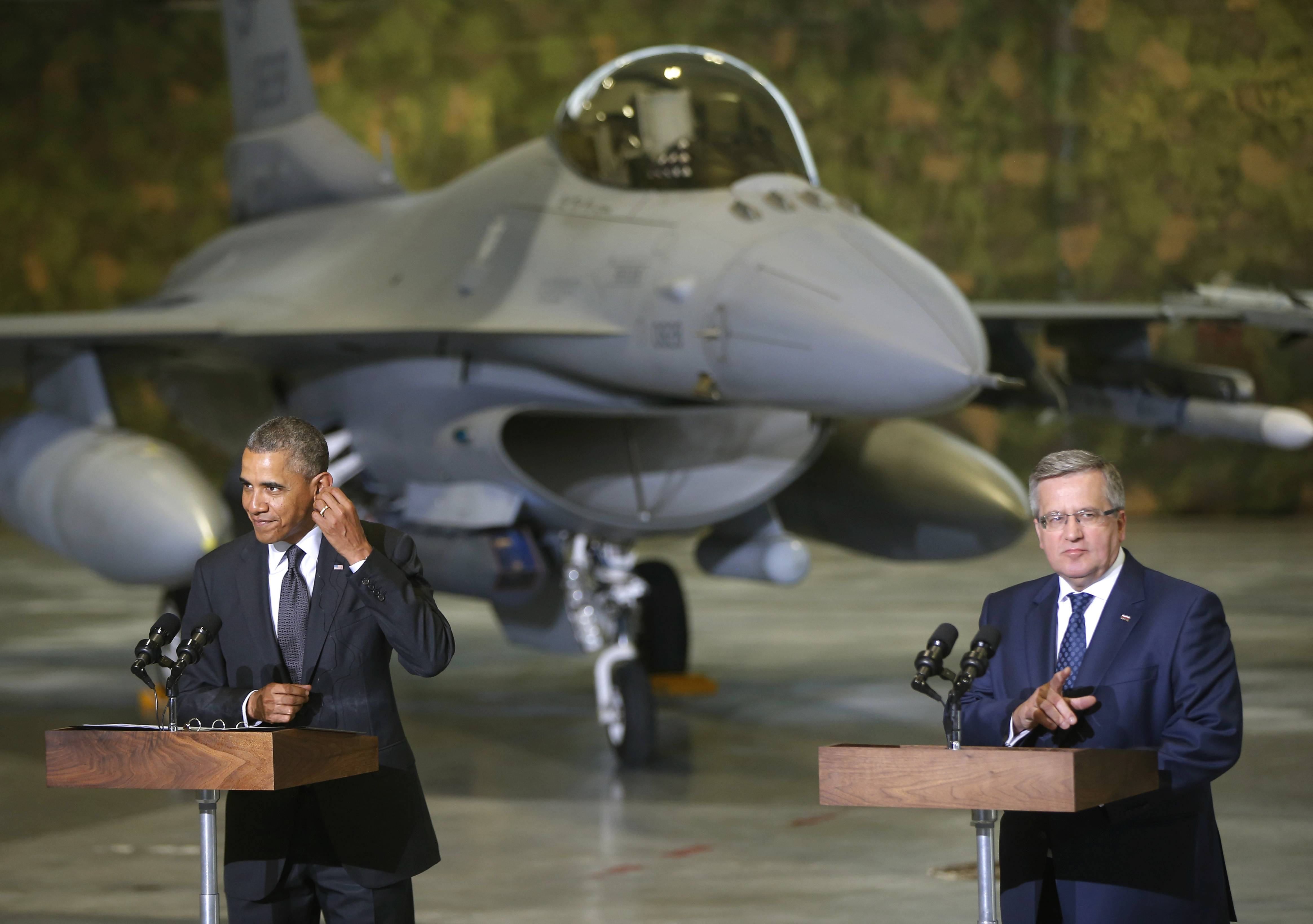 President Barack Obama and Poland's President Bronislaw Komorowski make statements and meet with U.S. and Polish troops at an event featuring four F-16 fighter jets, two American and two Polish, as part of multinational military exercises, in Warsaw on Tuesday.