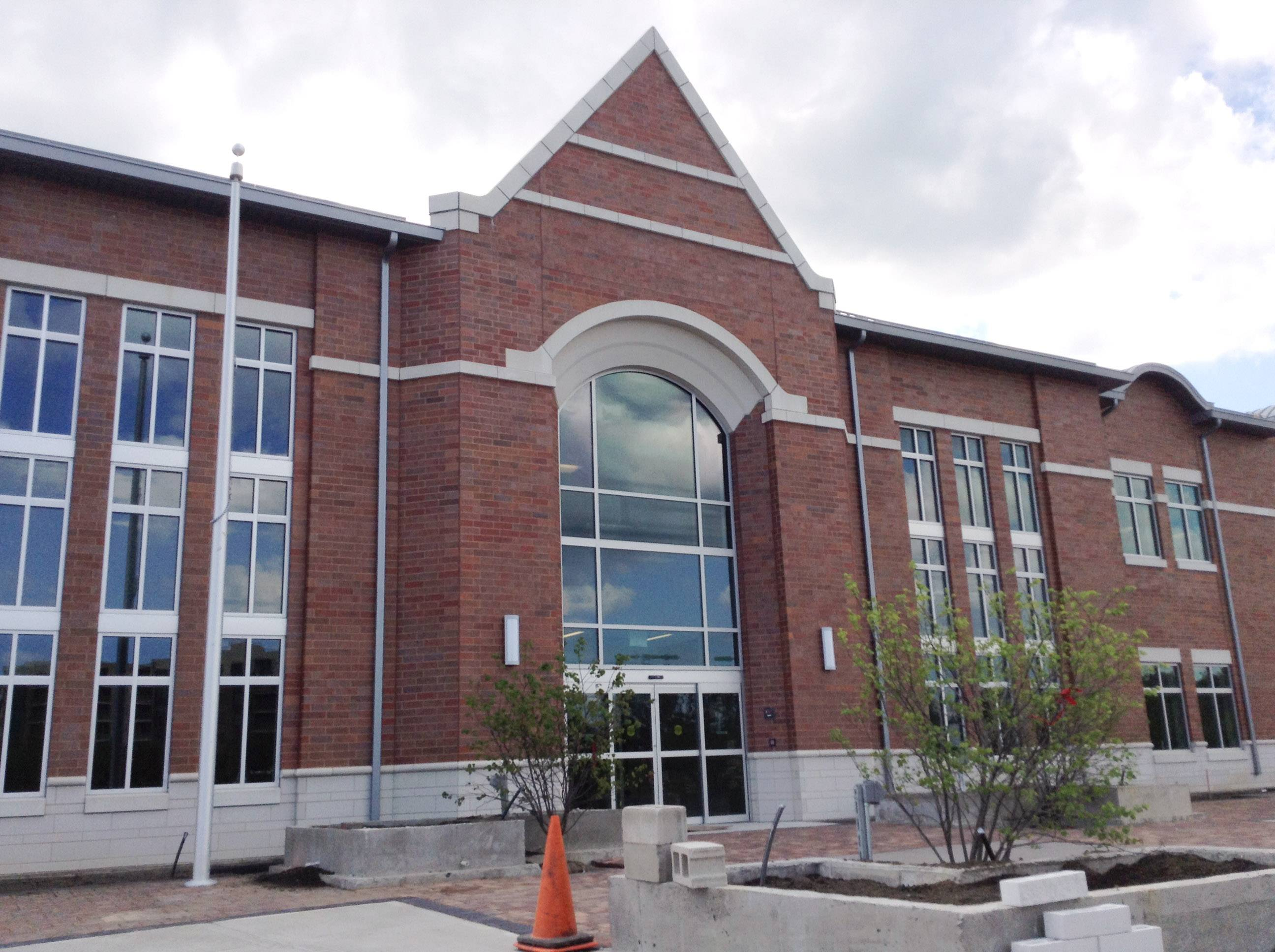The opening of Mundelein's new village hall is delayed until June 23, officials said, because some elements of the construction aren't completed.