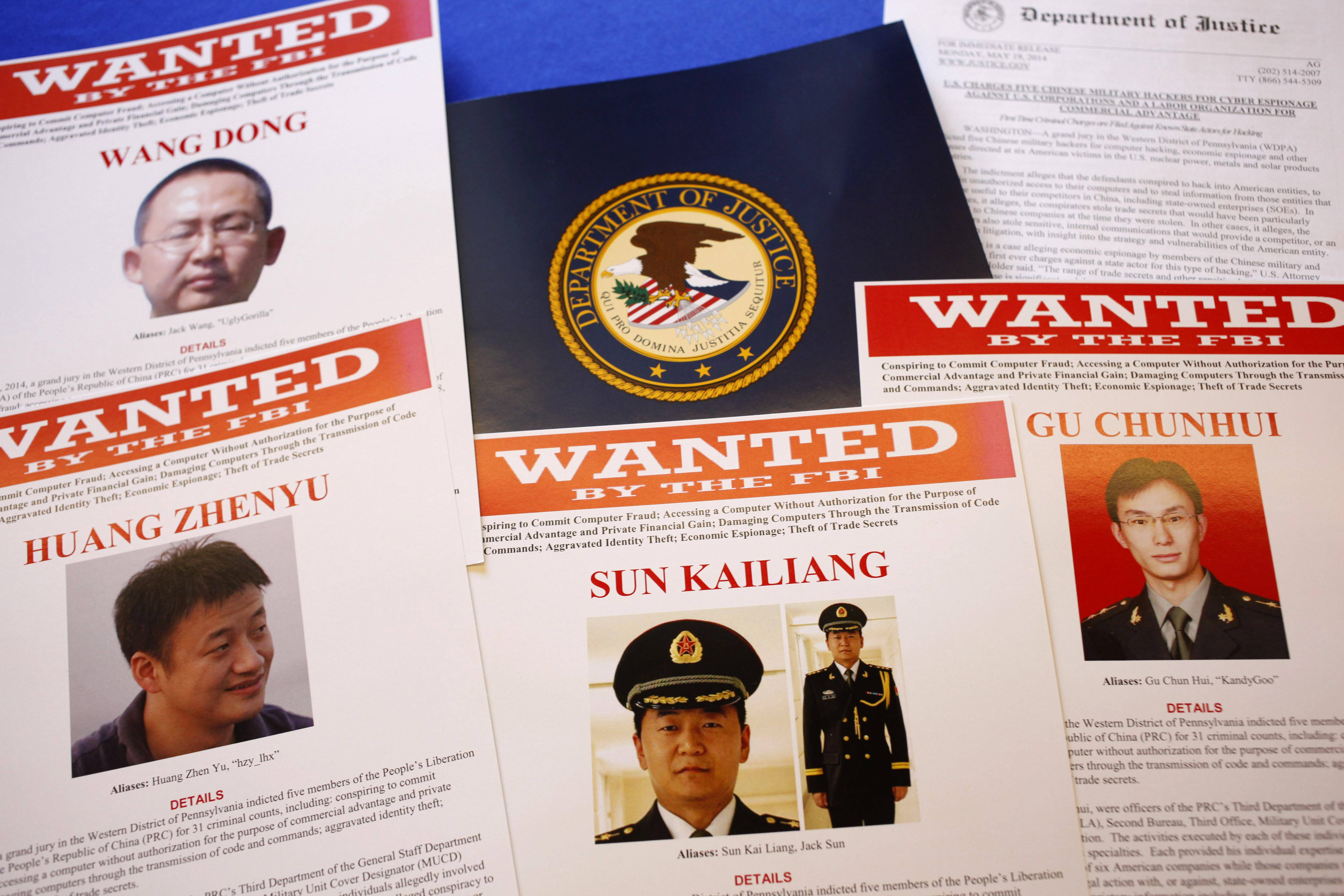 Press material displayed at the Justice Department in Washington before a press conference by U.S. Attorney General Eric Holder to announce charges of economic espionage and trade secret theft against five Chinese military officers, all hackers in an international cyber-espionage case.