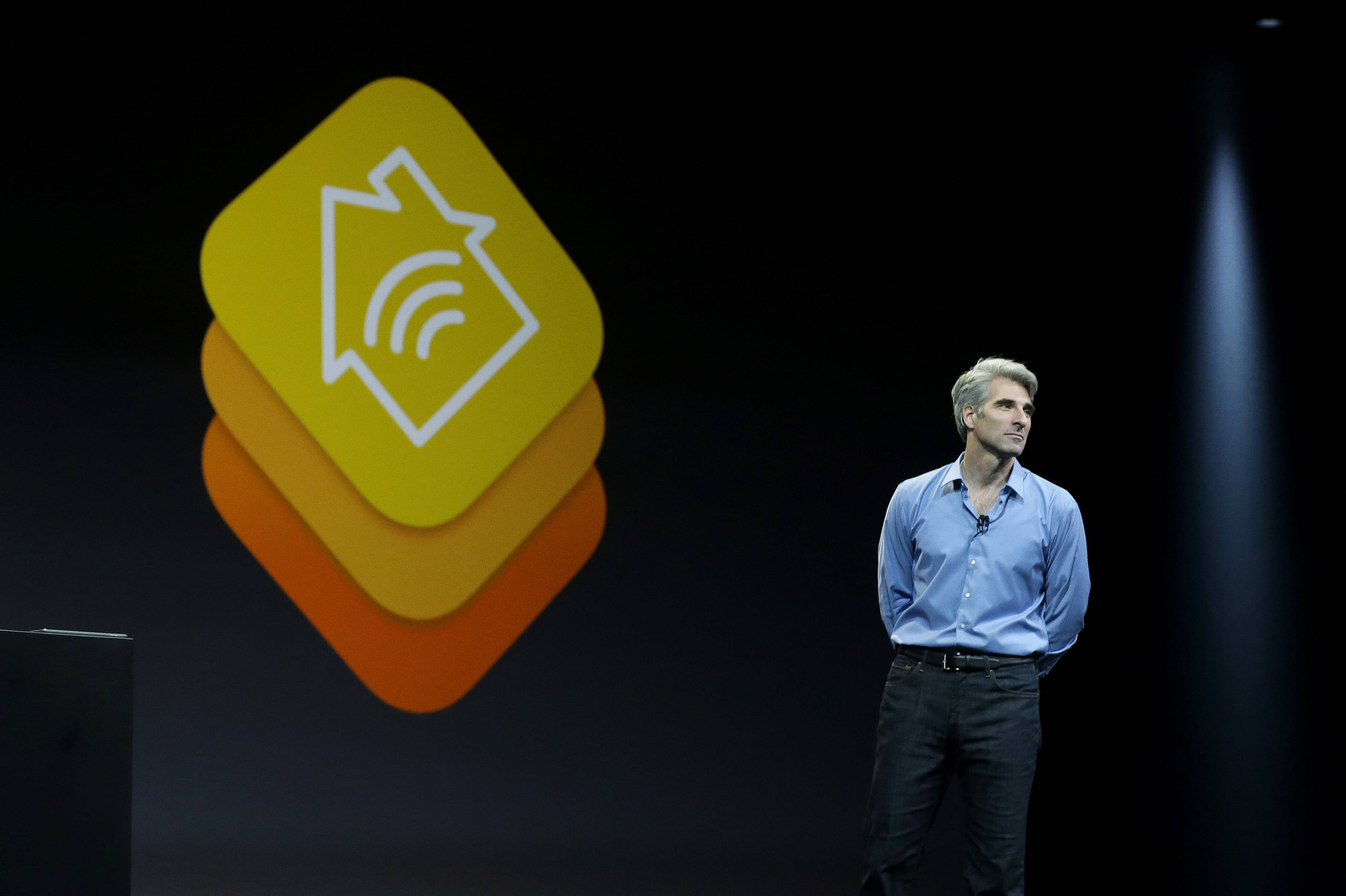 Apple senior vice president of Software Engineering Craig Federighi speaks about the Apple HomeKit app at the Apple Worldwide Developers Conference in San Francisco, Monday.