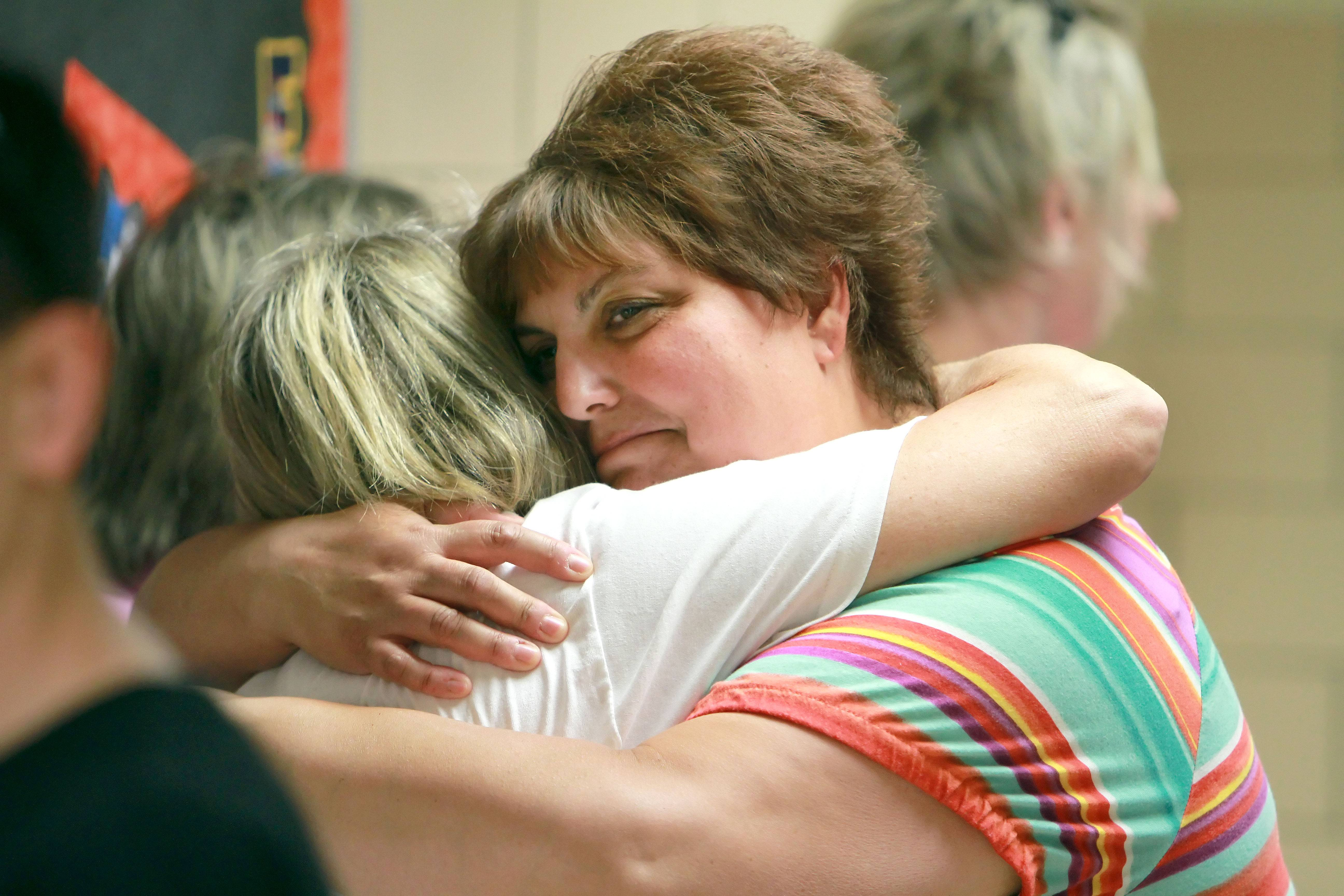 Carleen Sliwa, right, hugs Emily Rosemann as alumni of Pleviak Elementary School got a chance to say goodbye to the building during an open house Tuesday in Lake Villa.