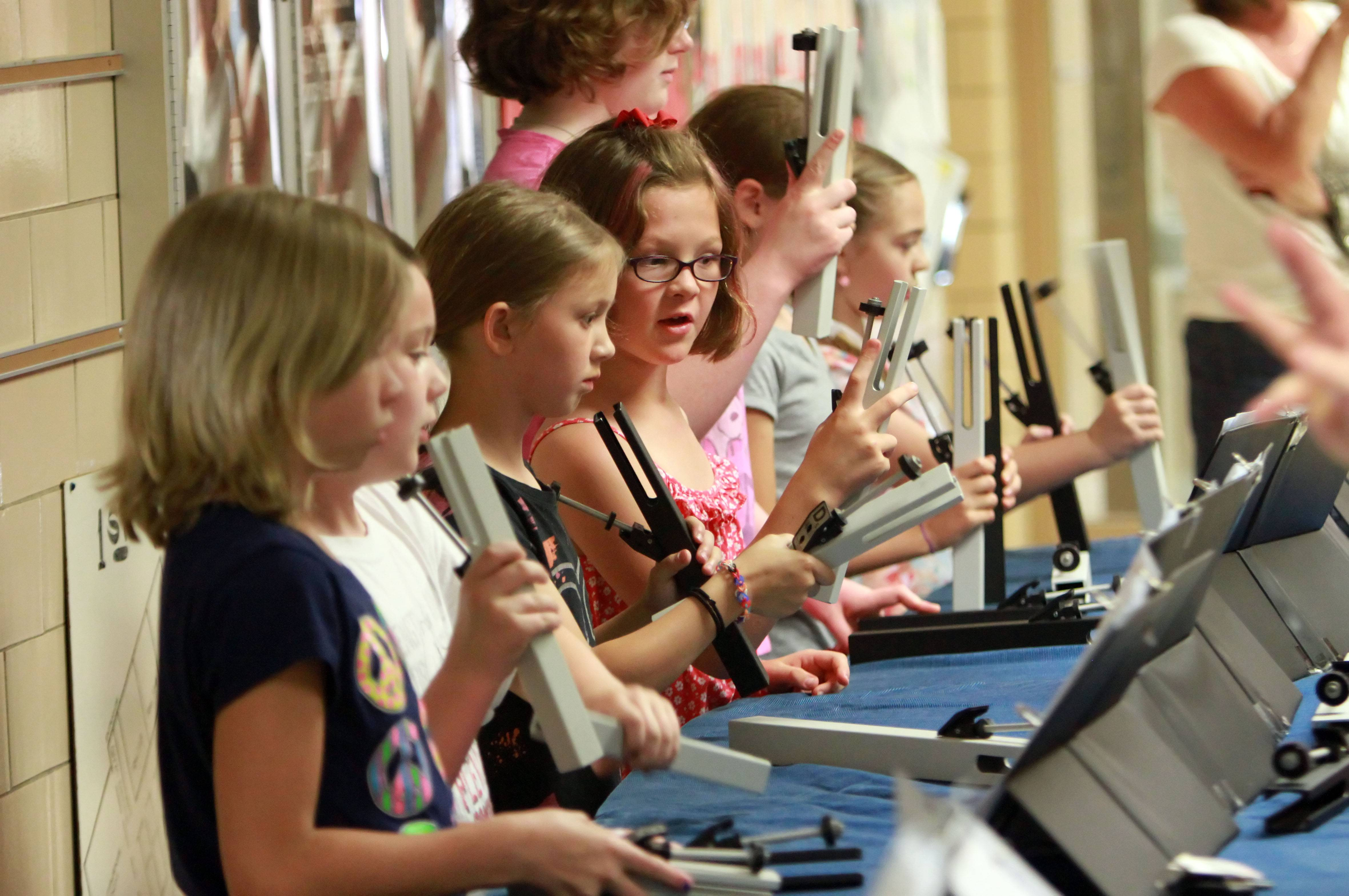 Third- and fourth-graders play tone chimes during an open house Tuesday at Pleviak School in Lake Villa.