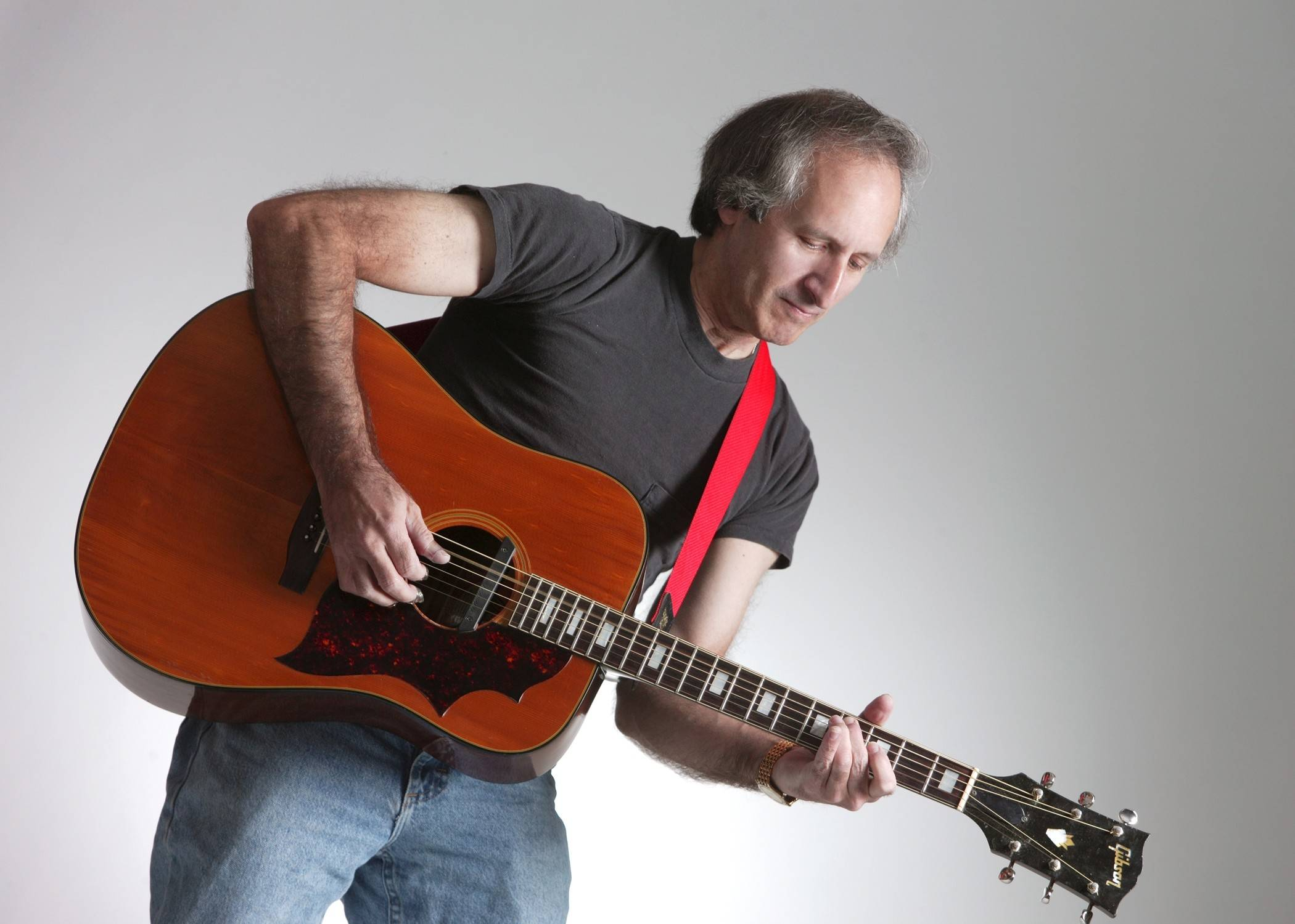 """Jazzman"" Jeff Justman will be the master of ceremonies at the Schornick Theatre and perform artistic acoustic guitar Beatle Jazz, '60s music and original songs."